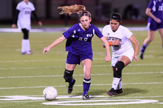 Wylie's Jacqueline Williams (20) beats a Wichita Falls High defender to the ball at Bulldog Stadium on Wednesday, Feb. 20, 2019. The Lady Bulldogs fell 4-2 in penalty kicks after tying 1-1 in regulation.