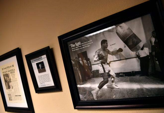 A photograph of boxer Muhammad Ali, displayed alongside one of several personal heroes to Mayor Anthony Williams, hangs in his office at Abilene Christian University.