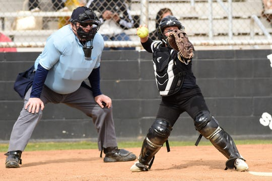 Abilene High catcher Hannah Lopez (9) sets to throw to first base against Lubbock High during the 2020 Abilene Ice Breaker. Lopez developed into an elite catcher for the Lady Eagles over her three years on varsity. She will attend Texas Tech in the fall.