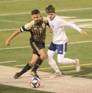 Abilene High's Joseph Martinez, left, fights a Hurst Bell for the ball. Bell beat the Eagles 1-0 in the District 3-6A game Wednesday, Feb. 20, 2019, at Shotwell Stadium.