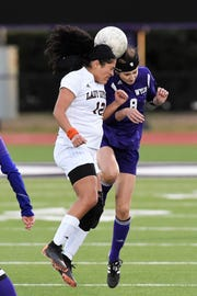 Wylie's Logan Bourland (8) and Wichita Falls High's Maria Gonzalez (12) go up for a header at Bulldog Stadium on Wednesday, Feb. 20, 2019. The Lady Bulldogs fell 4-2 in penalty kicks after tying 1-1 in regulation.