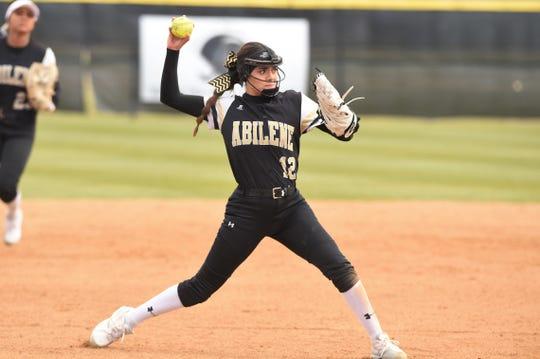 Abilene High third baseman Aubriana Salazar (12) throws to first for an out against Lubbock High in the Abilene Ice Breaker on Thursday, Feb. 21, 2019.