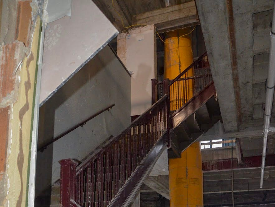Floors of Heritage Tower are expected to be completed by April 2019, with leasing potentially beginning in June. Pictured is a staircase leading from the 18th to the 19th floor of the building.