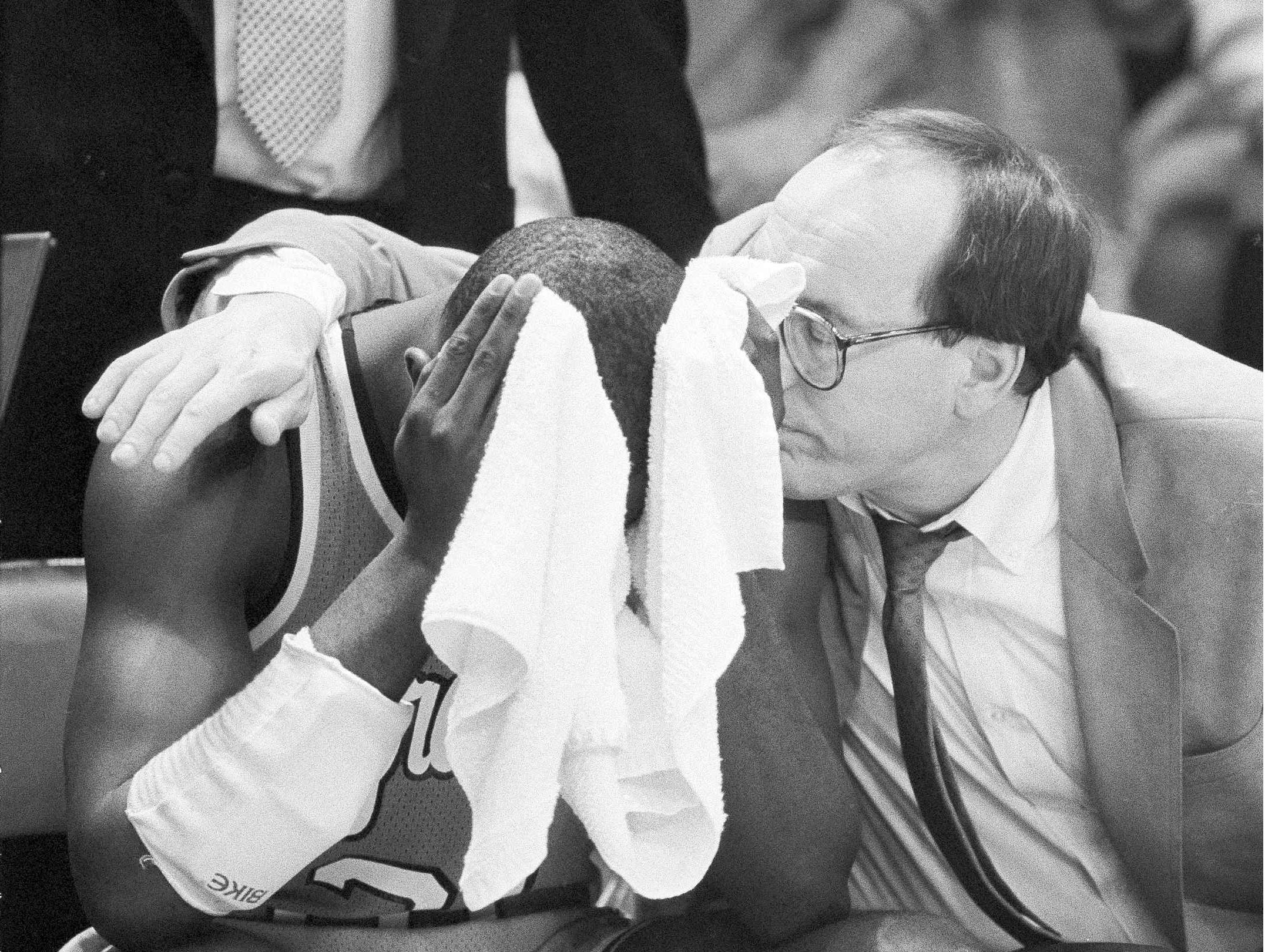 1986: Dwayne Washington is consoled by Syracuse coach Jim Boeheim, right, after his shot at the buzzer was blocked by St. John's Walter Berry to give No. 5 St. Joh's a 70-69 win in New York for the Big East championship and an automatic berth in the NCAA tournament, March 9, 1986. Washington, who led all scorers iwth 20 points and 14 assists, was the tourney's most valuable player. (AP Photo/Ray Stubblebine)