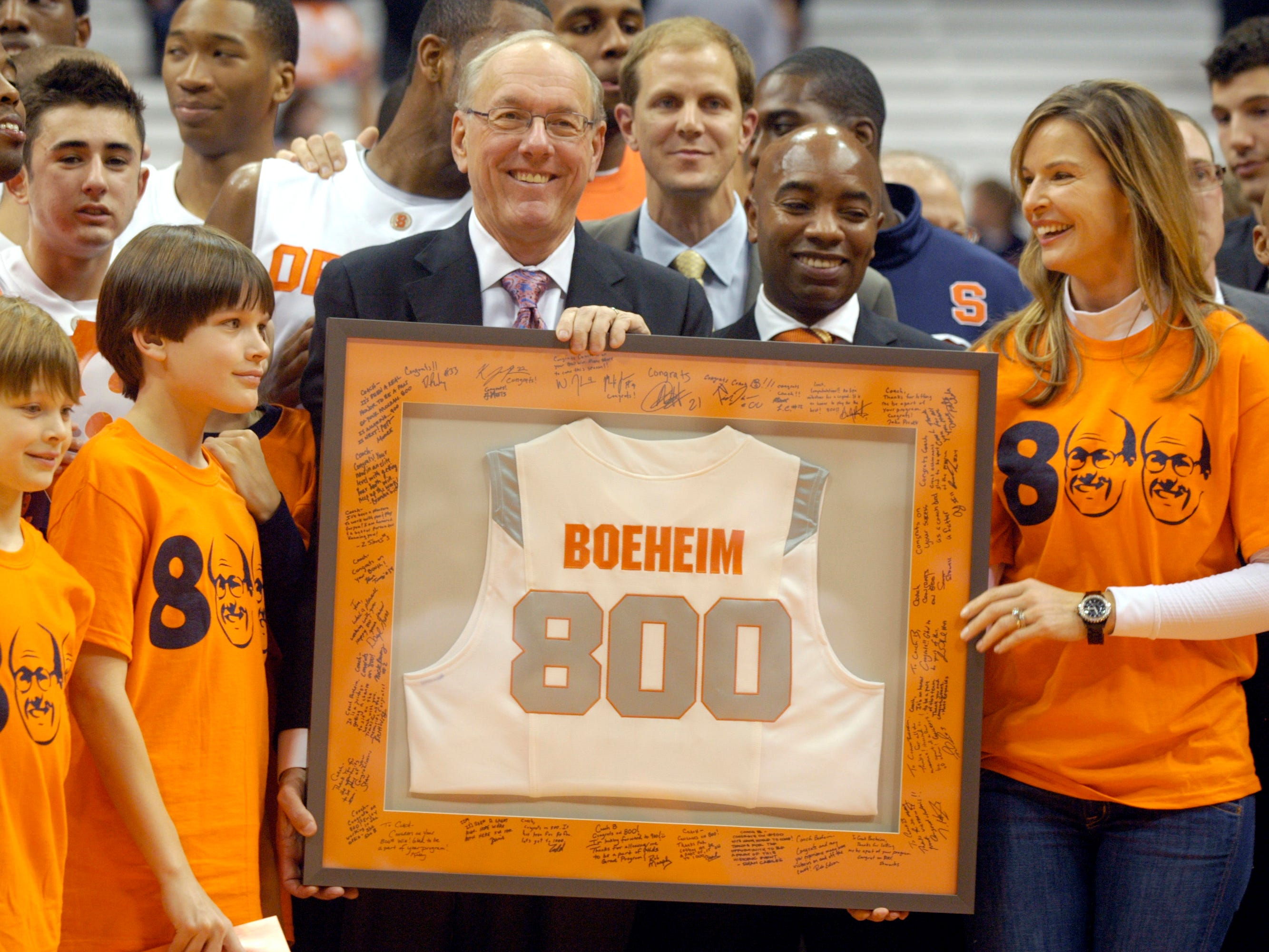 2009: Syracuse head coach Jim Boeheim, center, celebrates his 800th win after defeating Albany 75-43 in the Coaches vs. Cancer tournament game in NCAA college basketball in Syracuse, N.Y., Monday, Nov. 9, 2009. (AP Photo/Kevin Rivoli)