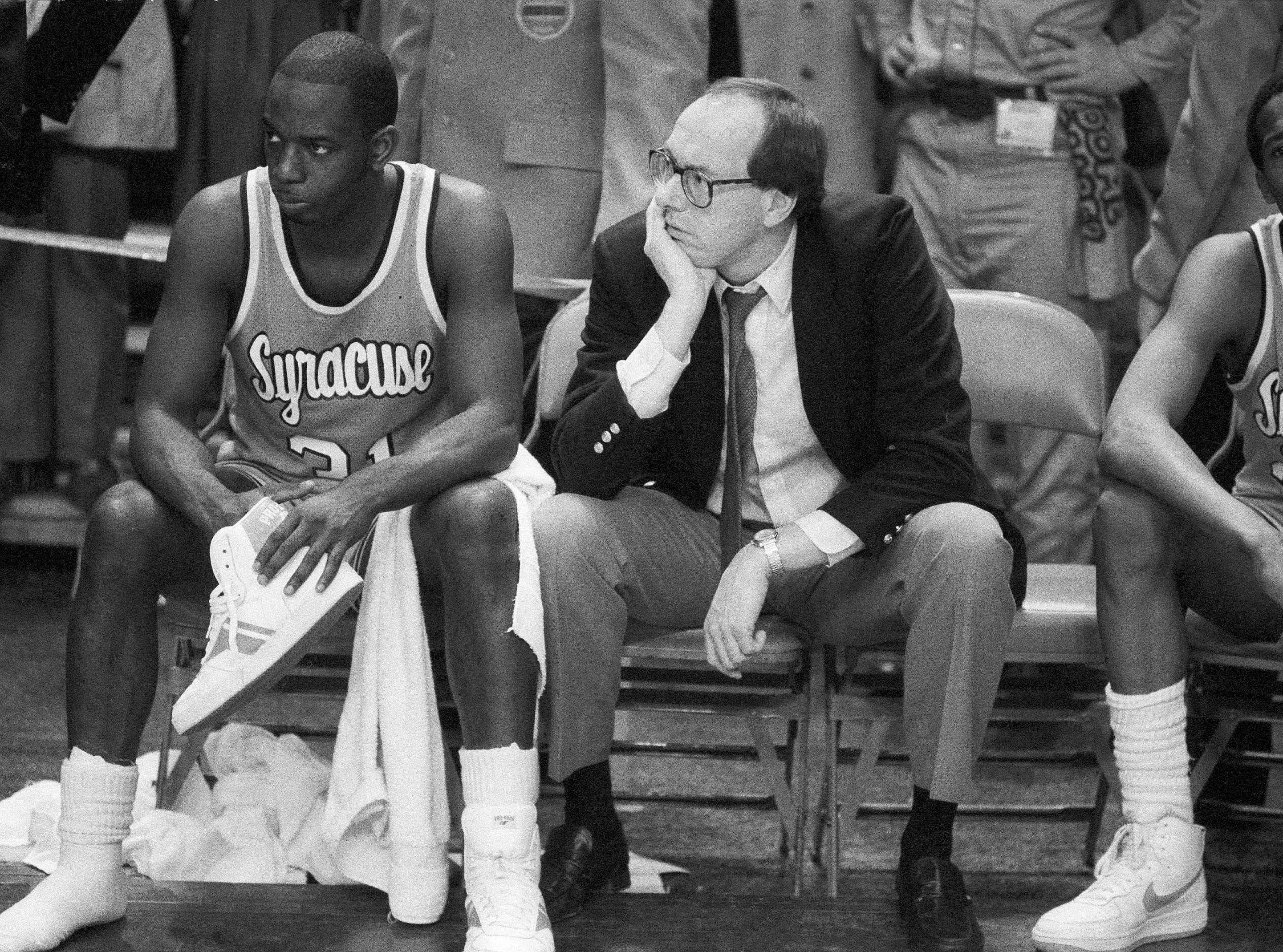 1984: Syracuse coach Jim Boeheim, right, and Syracuse player Dwayne Washington (31) watch as Georgetown University took control in overtime of the Big East Conference championship basketball game at Madison Square Garden in New York. Syracuse coach Jim Boeheim, current and former players, and others associated with the program continue to rally in support of former Orange star Dwayne Pearl Washington, who's afflicted with brain cancer.  (AP Photo/Ray Stubblebine, File)