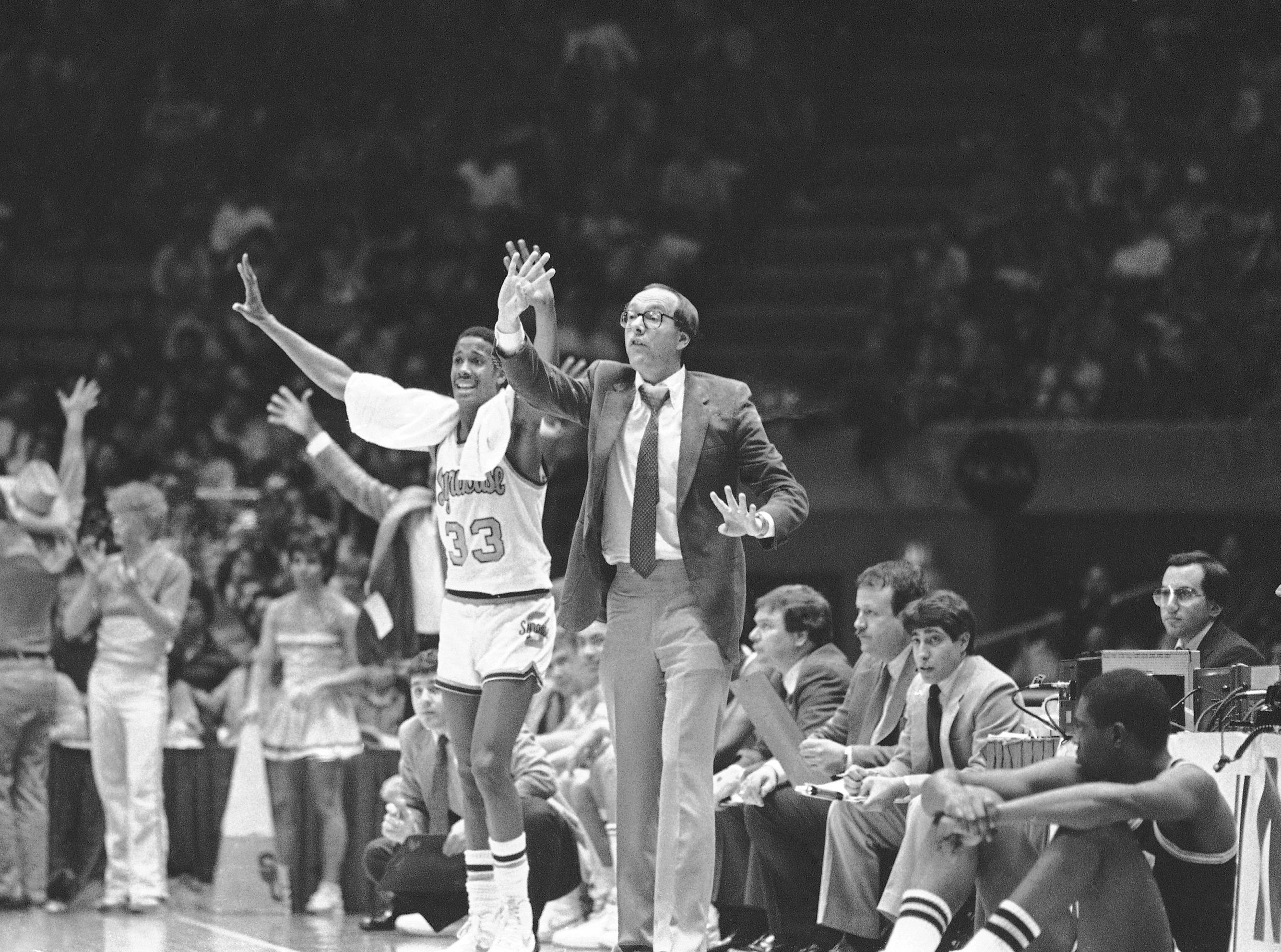 1983: Syracuse head coach Jim Boeheim, right, and Gene Waldron show their anxiety as their team makes last shot in their winning second round NCAA Championship Game against Virginia Commonwealth by a score of 78-63, Sunday, March 18, 1983, East Rutherford, N.J. (AP Photo/Mike Derer)