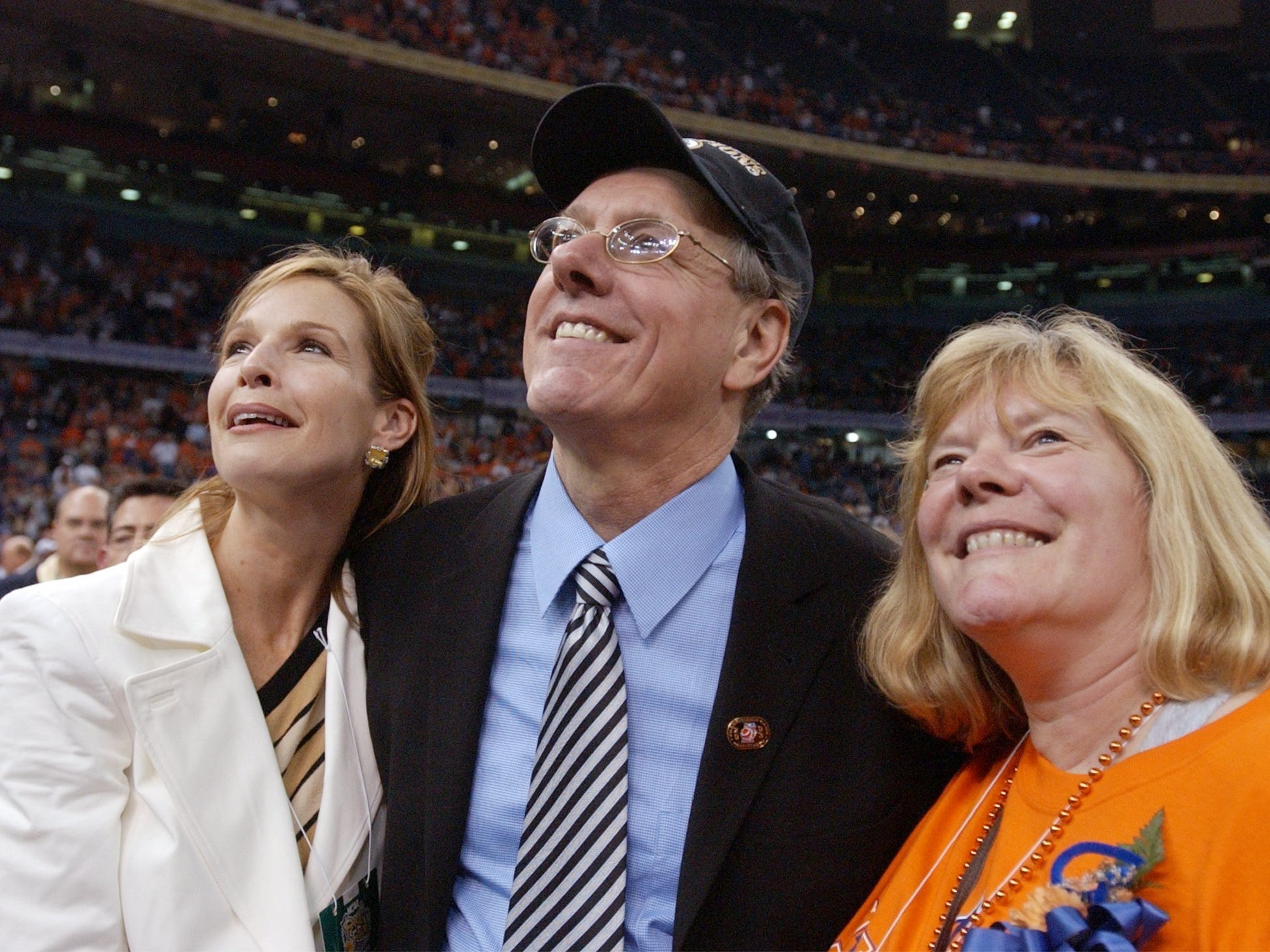 2003: Syracuse head coach Jim Boeheim, center, celebrates the Orangemen 81-78 victory over the Kansas Jayhawks with his wife Julie, left, and sister Barbara following their NCAA Championship at the Louisiana Superdome in New Orleans, Louisiana, Monday, April 7, 2003. (nk) 2003