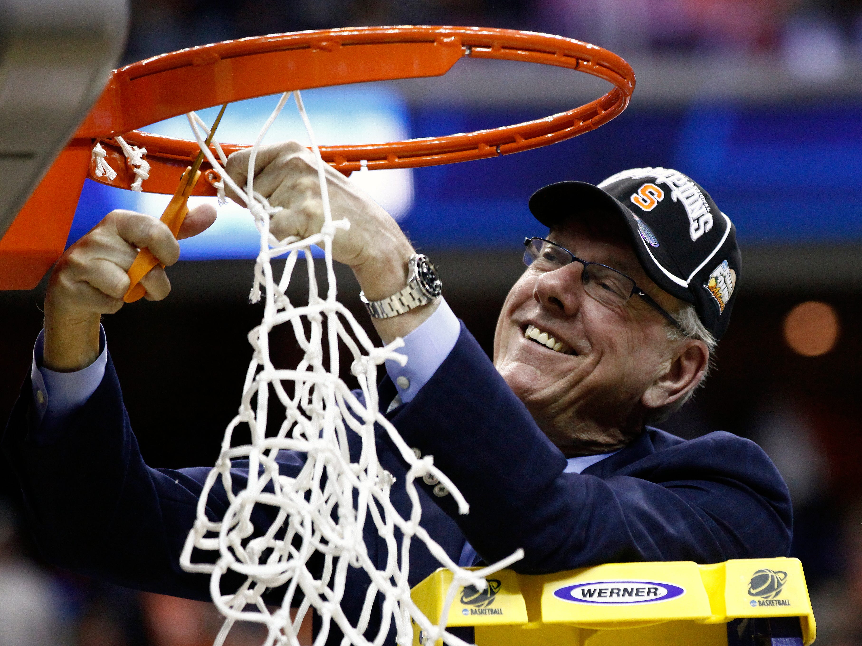 2013: Syracuse head coach Jim Boeheim cuts down the net sfterthe East Regional final in the NCAA men's college basketball tournament, Saturday, March 30, 2013 in Washington. Syracuse defeated Marquette 55-39 to advance to the Final Four in Atlanta. (AP Photo/Mark Tenally)