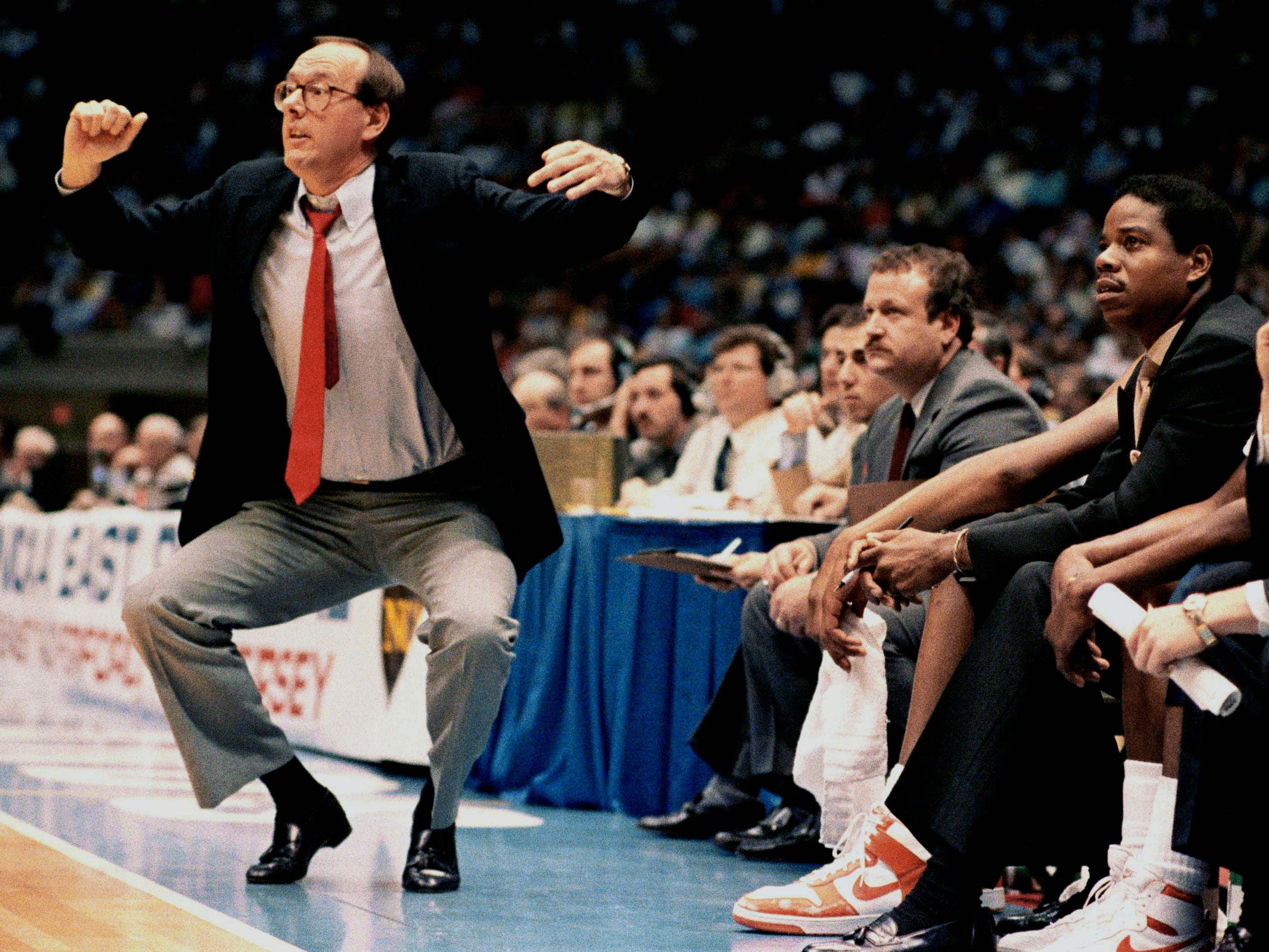 1987: Syracuse coach Jim Boeheim uses some body language during the first half of the NCAA East Regional Final against North Carolina  Saturday, March 21, 1987 in East Rutherford, New Jersey.