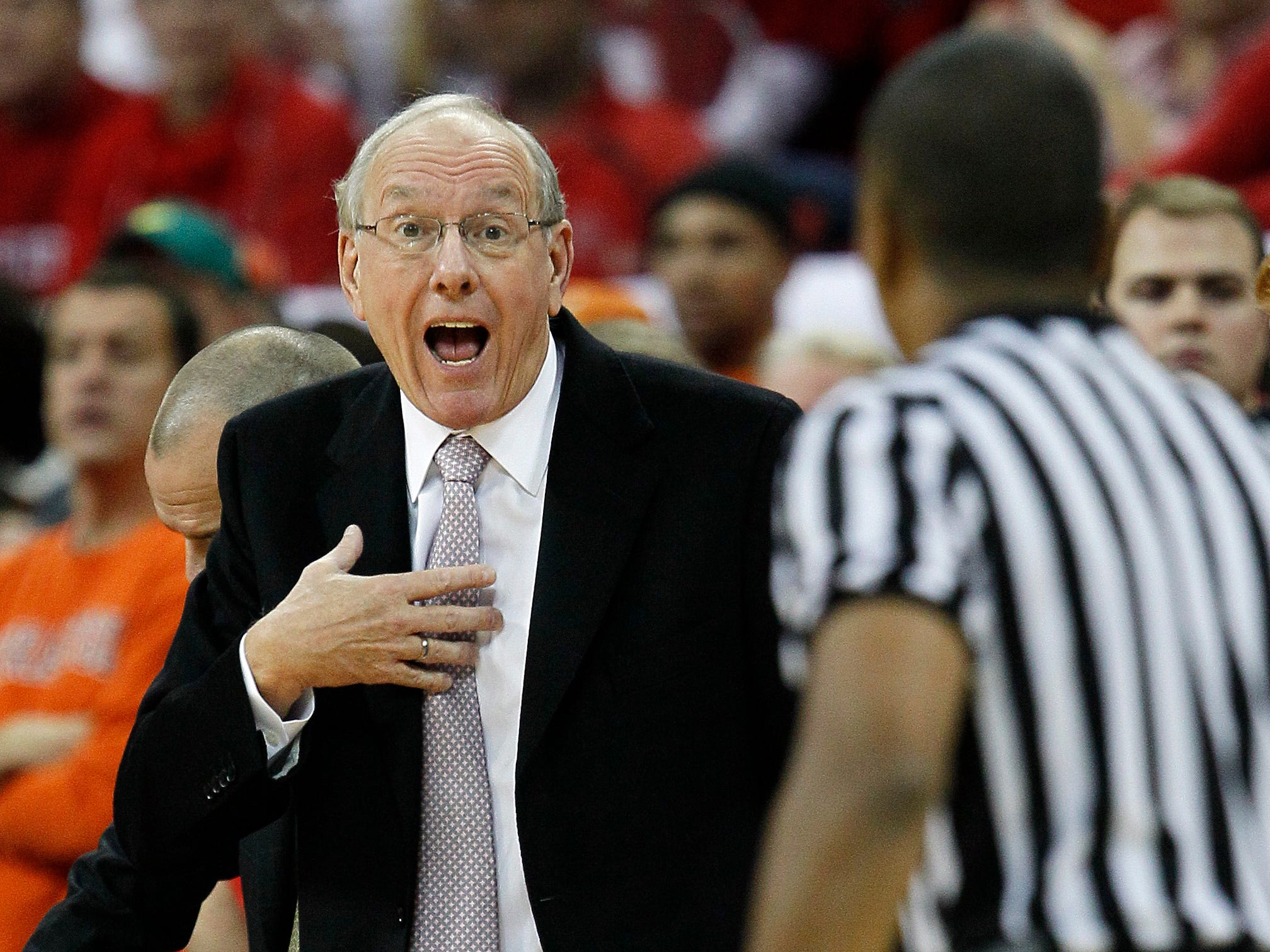2011: Syracuse coach Jim Boeheim speaks with an official during the first half of an NCAA college basketball game against North Carolina State in Raleigh, N.C., Saturday, Dec. 17, 2011. Syracuse won 88-72. (AP Photo/Gerry Broome)