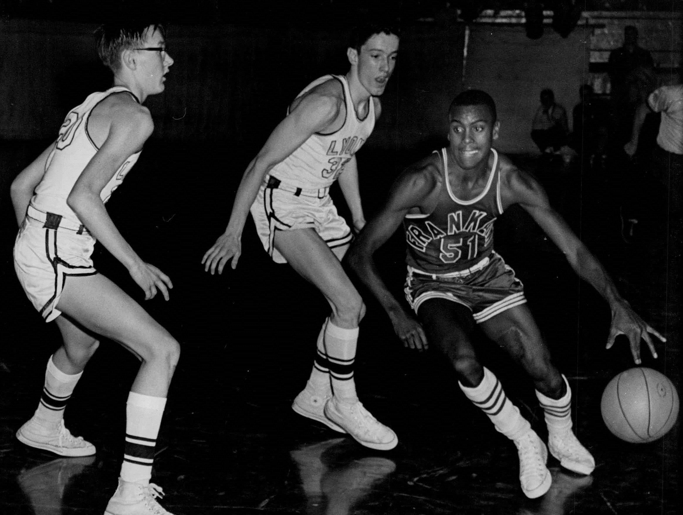 1961: Trent Jackson of Franklin, right, dribbles past two Lyons defenders, including Jim Boeheim, left, in the 1961 Section V Class AA semifinals. Franklin won the game but lost to Webster in the championship.