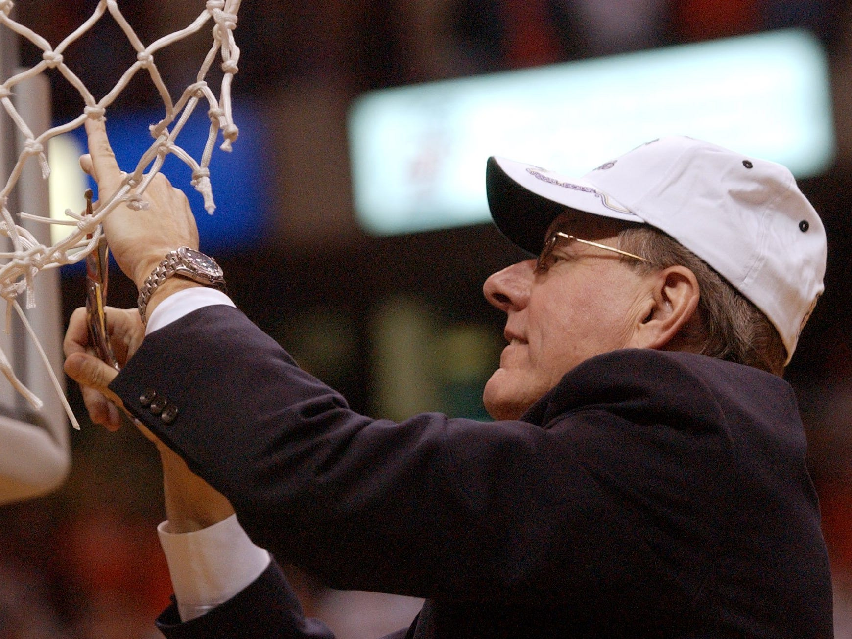 2003: Syracuse head coach Jim Boeheim cuts the net after Syracuse beat Oklahoma 63-47 in the NCAA men's basketball east regional final Sunday, March 30, 2003, in Albany, N.Y. (AP Photo/David Duprey)