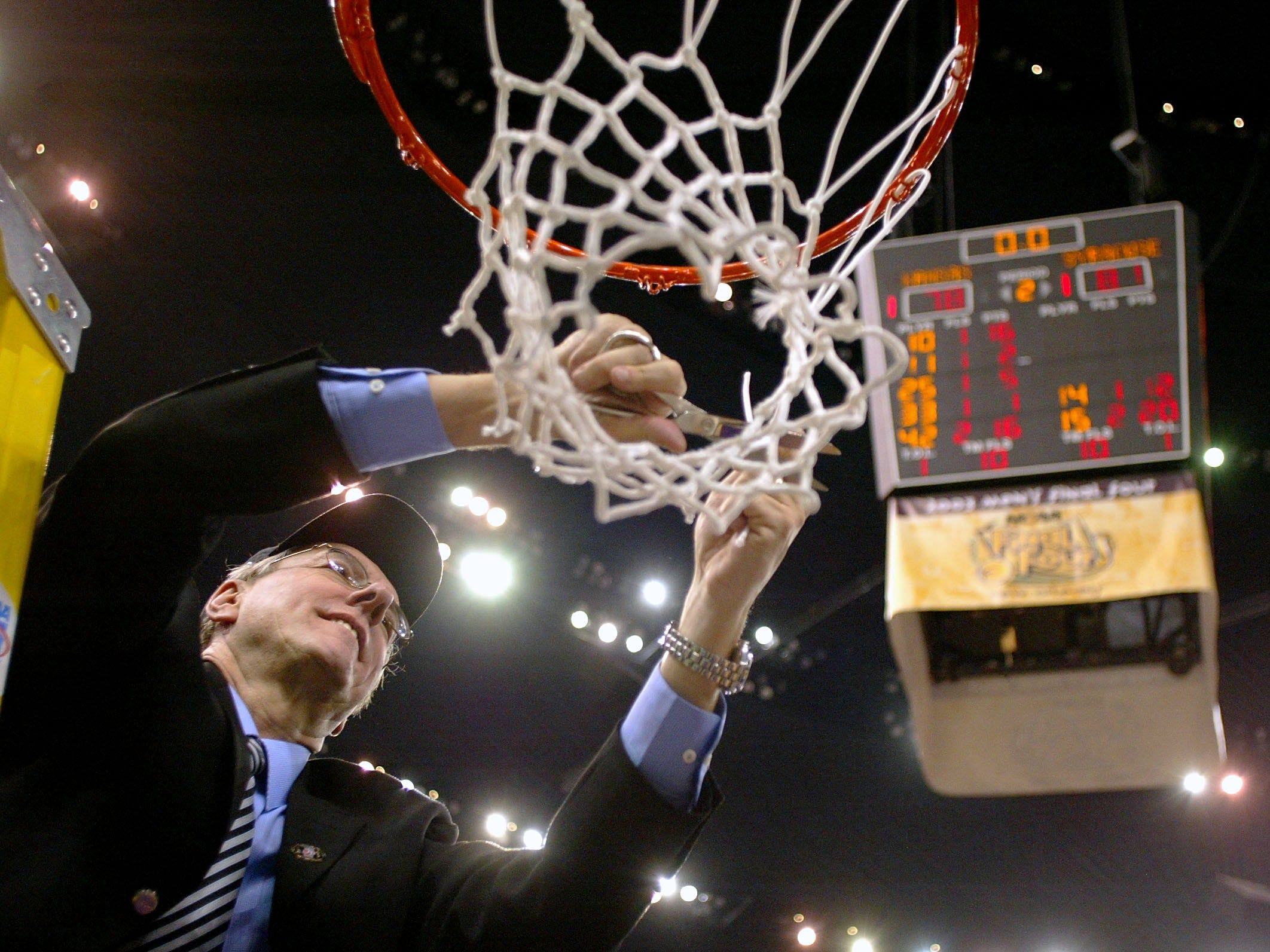 2003: Head coach Jim Boeheim of Syracuse cuts down the net after he and his team defeated Kansas 81-78 during the championship game of the NCAA Men's Final Four Tournament on April 7, 2003 at the Louisiana Superdome in New Orleans, Louisiana.  (Photo by Craig Jones/Getty Images)