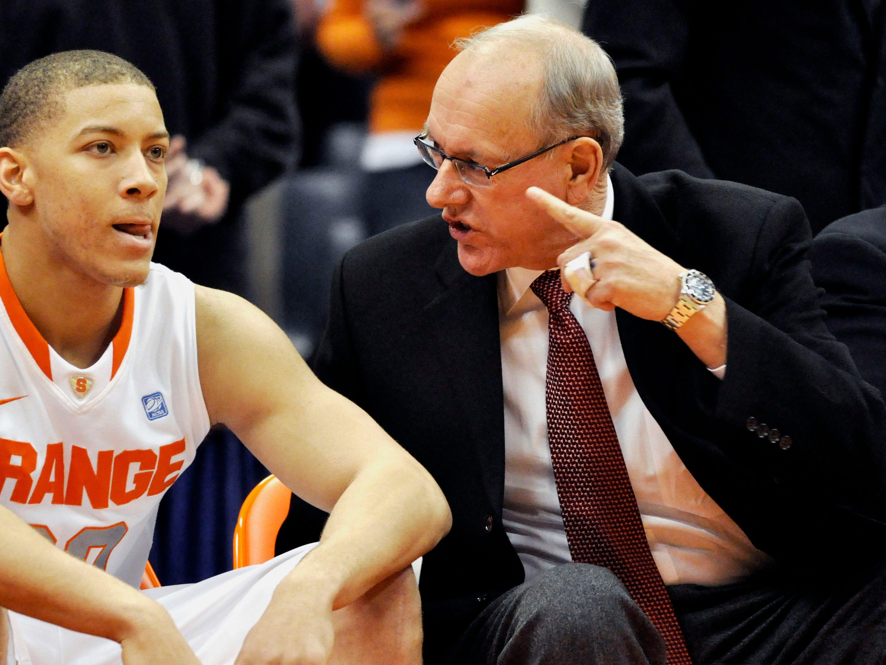 2010: Syracuse head coach Jim Boeheim, right, talks to Brandon Triche during the first half against Drexel in an NCAA college basketball game in Syracuse, N.Y., Wednesday, Dec. 22, 2010. Syracuse won 93-65. (AP Photo/Kevin Rivoli)