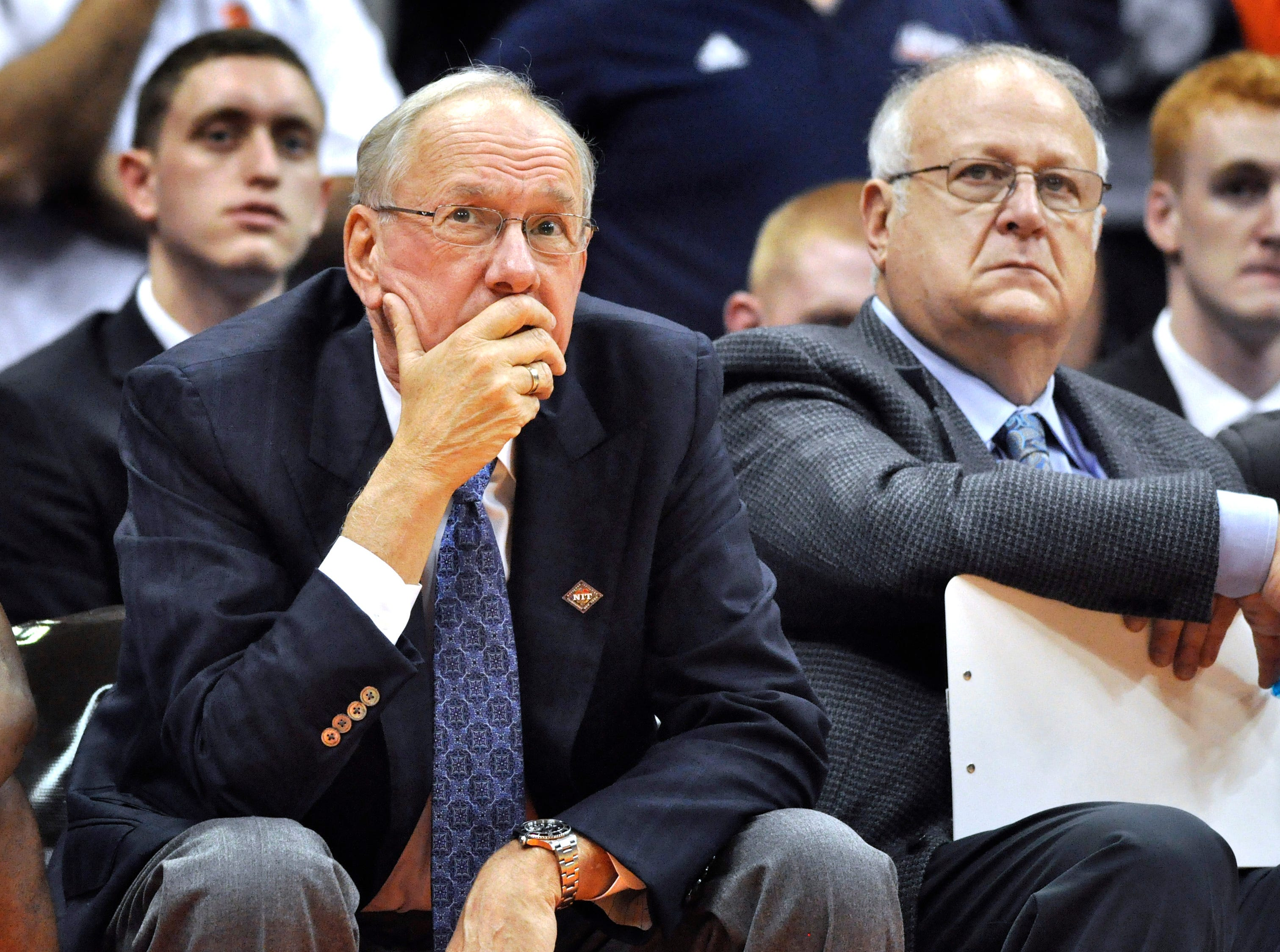 2011: Syracuse basketball coach Jim Boeheim, left, watches the action with assistant coach Bernie Fine,  during a college basketball game against Manhattan in the NIT Season Tip-Off in Syracuse, N.Y. Federal authorities have dropped their investigation into sexual abuse claims that cost a Syracuse University assistant basketball coach his job, threw a top-ranked team into turmoil and threatened the career of Hall of Fame coach Boeheim. After a probe spanning nearly a year, U.S. Attorney Richard Hartunian said Friday, Nov. 9, 2012 there was no evidence to support claims that Bernie Fine had molested a boy in 2002 in a Pittsburgh hotel room.  (AP Photo/Kevin Rivoli, File)