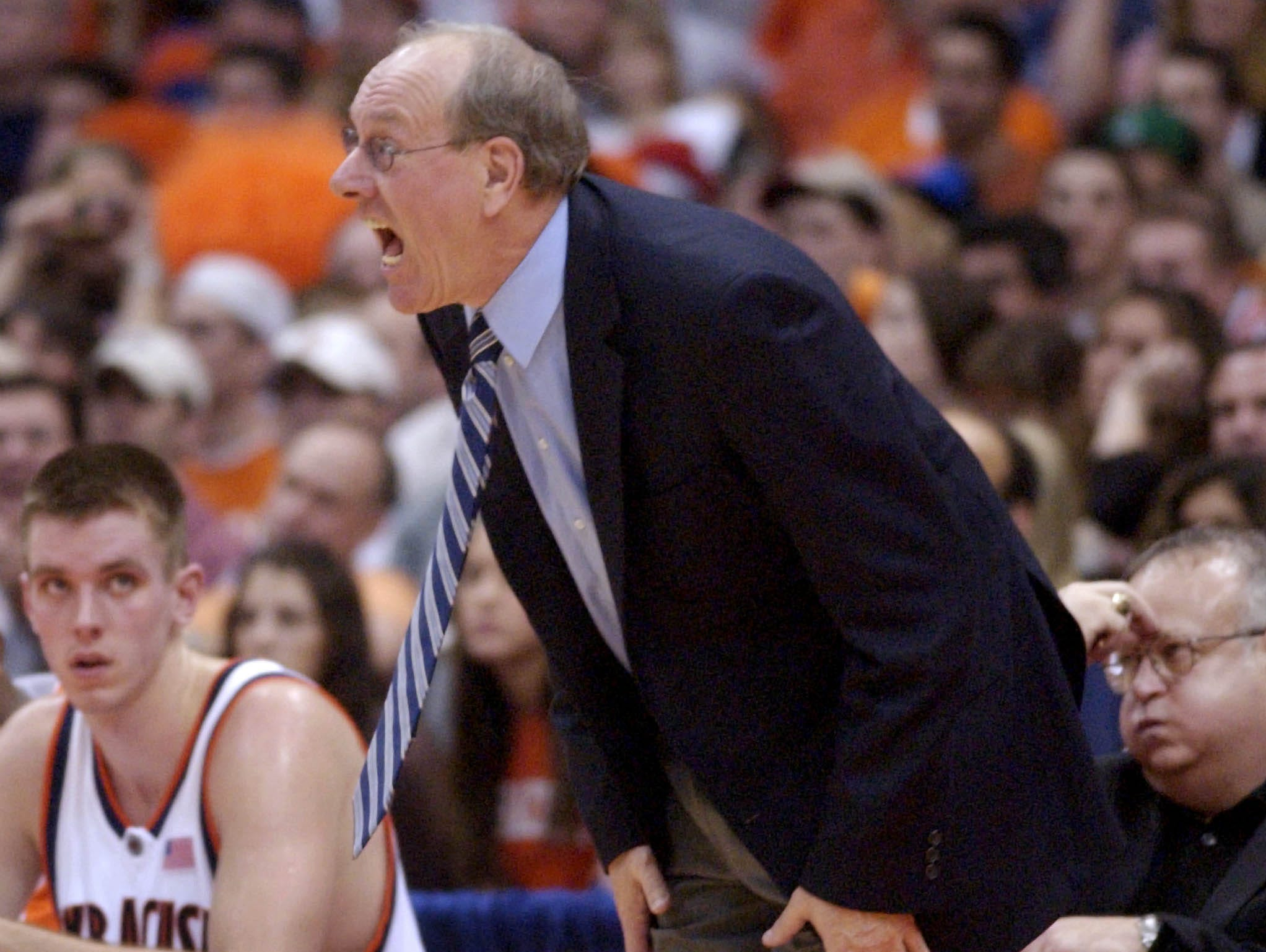 2004: Syracuse head coach Jim Boeheim yells instructions to his players during the second half against Michigan State in Syracuse, N.Y., Saturday, Jan. 3, 2004. Syracuse won 96-83. (AP Photo/Kevin Rivoli)