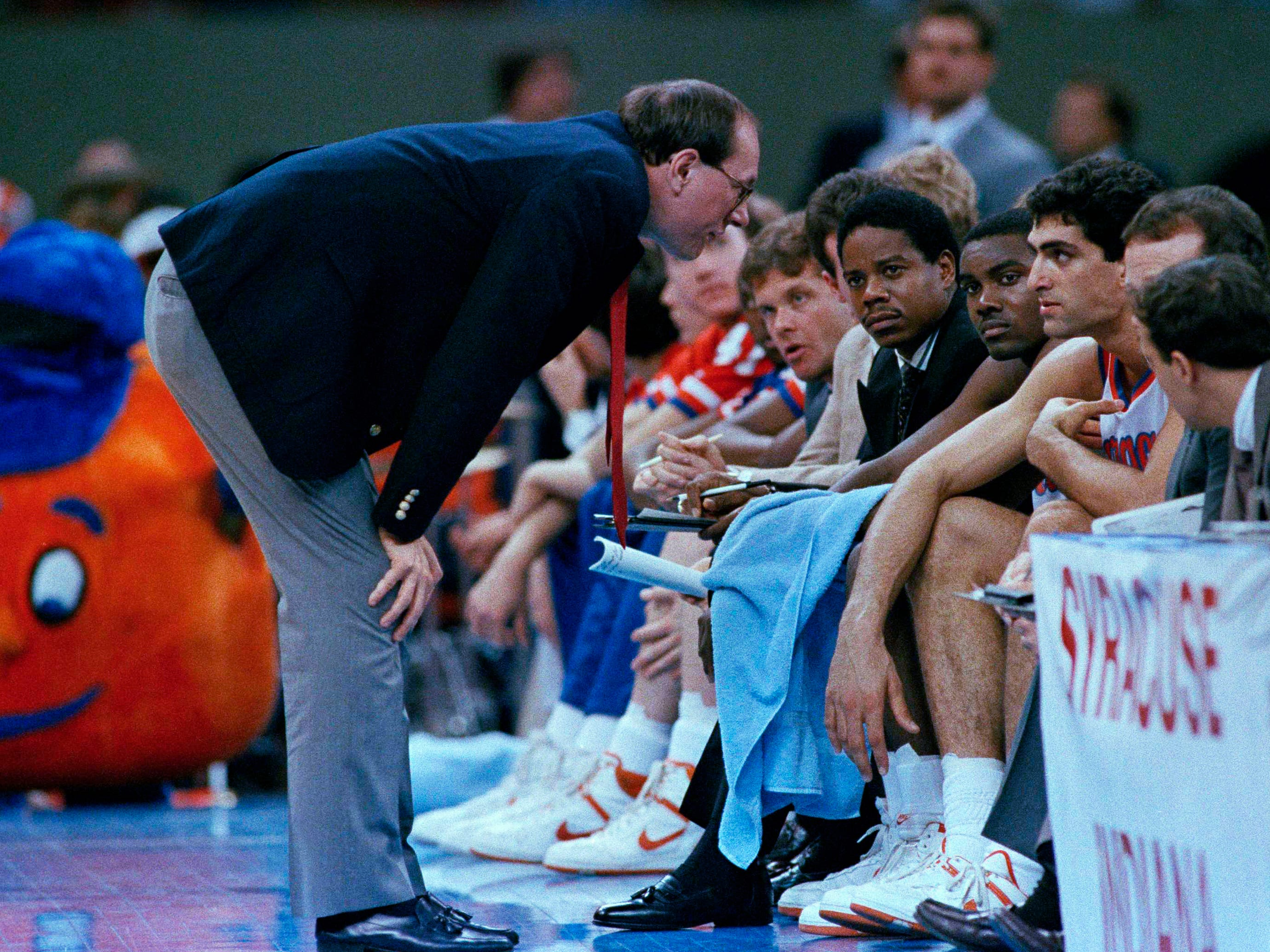 1987: Syracuse coach Jim Boeheim (left) talks to player Rony Seikaly (right) as he sits on the bench during their game against Providence in New Orleans, Saturday, March 28, 1987.