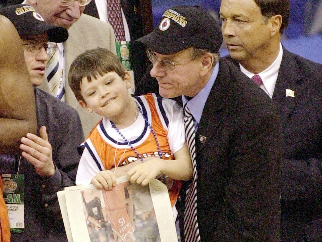 2003: Syracuse coach Jim Boeheim lifts his son Jim Jr. after defeating Kansas 81-78 in the NCAA men's final Monday, April 7, 2003 in New Orleans. (AP Photo/Bill Haber)