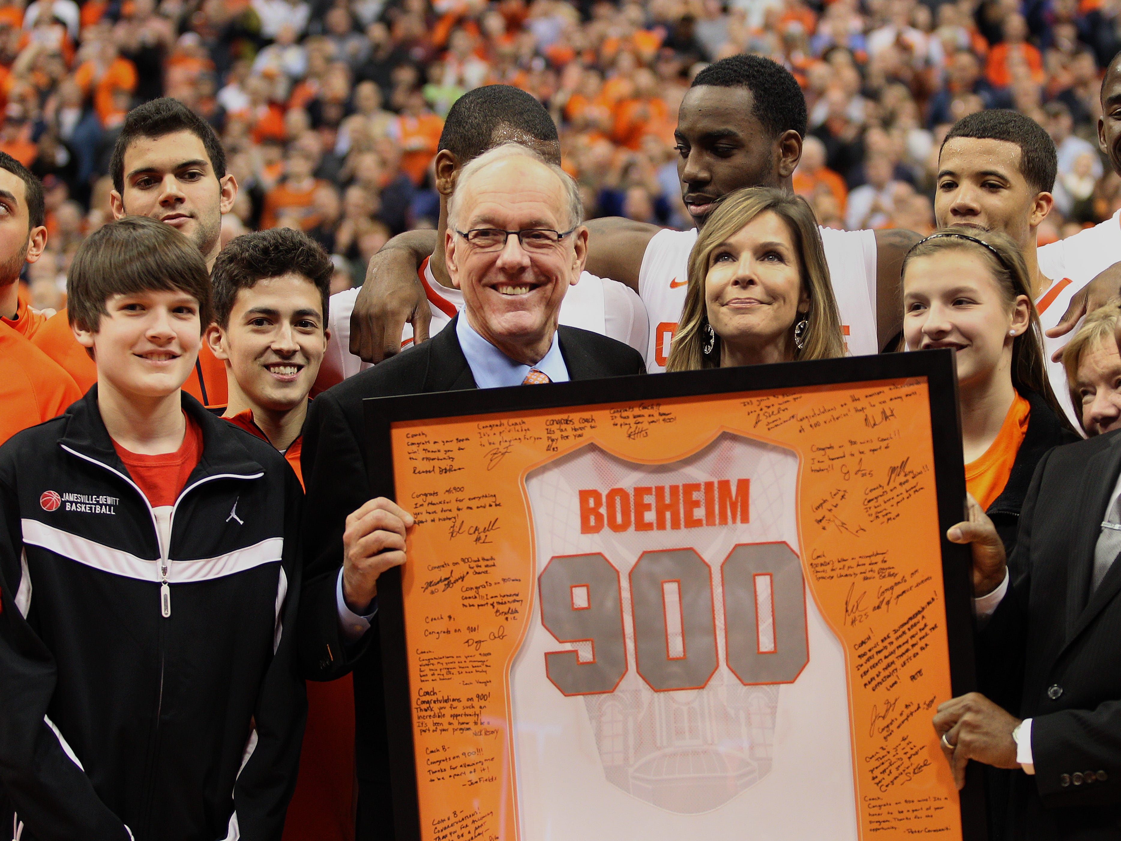 2012: Syracuse basketball coach Jim Boeheim with his family  (wife Juli in middle) and team after  his 900th career win  beating University of Detroit 72-68.