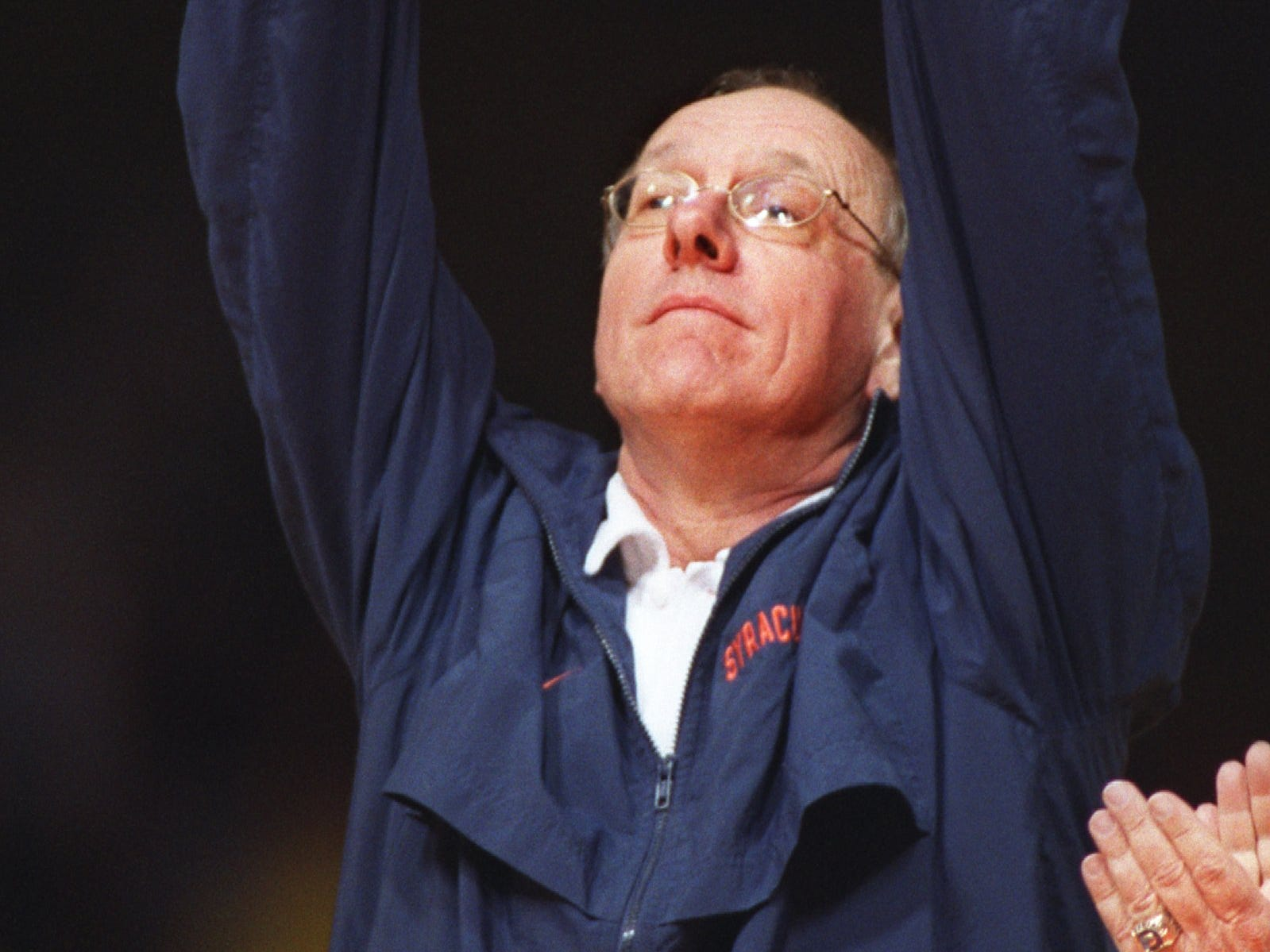 2003: Syracuse head basketball Jim Boeheim holds up the National Association of Basketball Coaches national championship trophy during an open celebration of the the Syracuse Orangemen's national championship Thursday, April 10, 2003, at the Carrier Dome in Syracuse, N.Y. (AP Photo/Post Standard, Jim Commentucci)