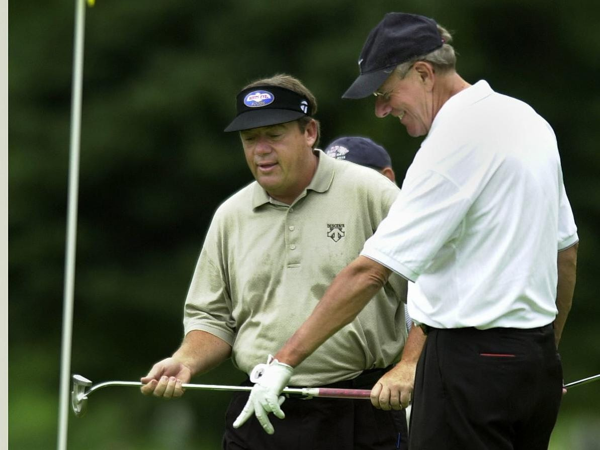 2004: PGA pro Joey Sindelar, left, and Syracuse University Basketball Coach Jim Boeheim compare their shots on the 12th green during the Pro-Am Wednesday at the B.C. Open.