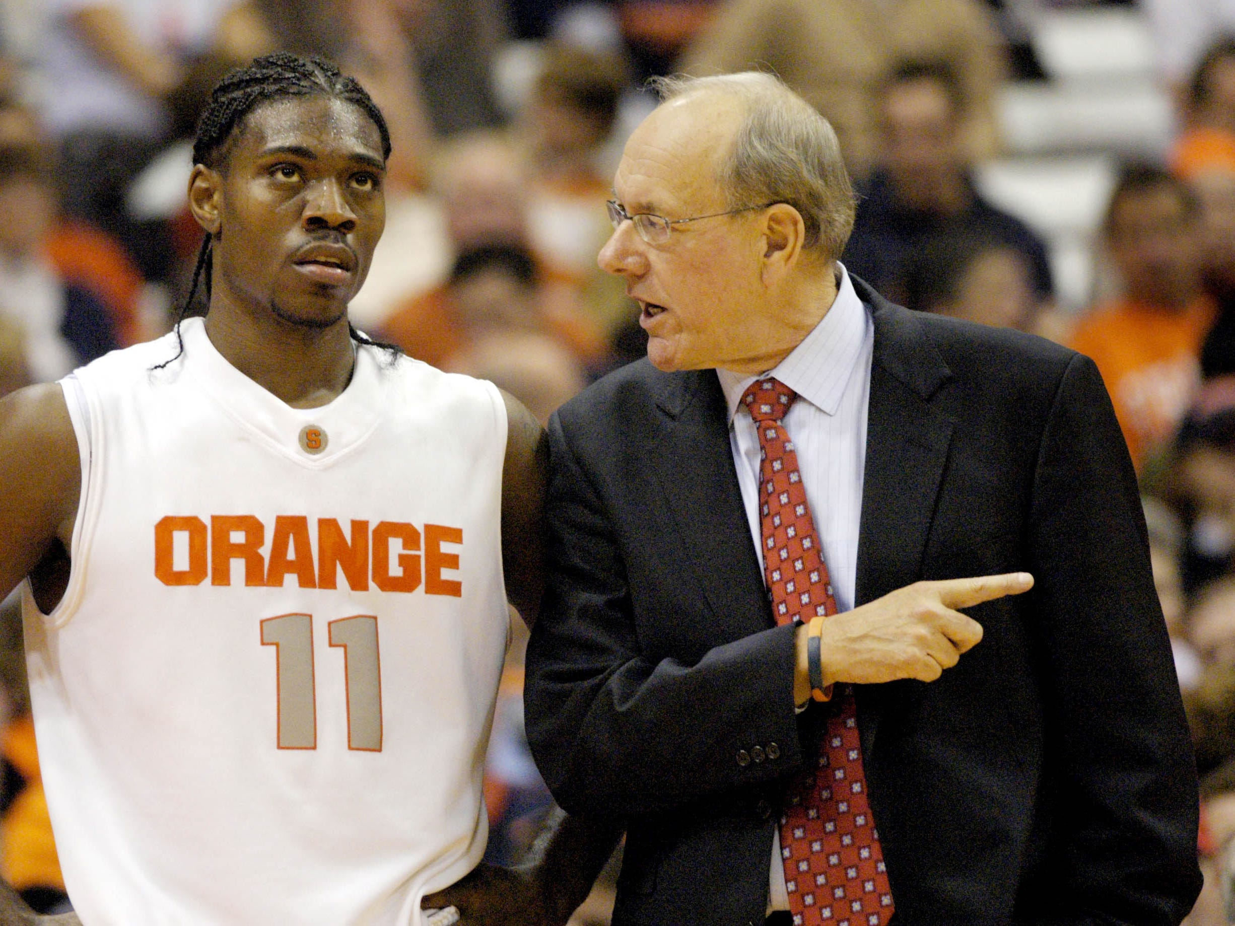 2007: Syracuse head coach Jim Boeheim, right, talks with player Paul Harris during the second half against Fordham in men's college basketball action in Syracuse, N.Y., Friday, Nov. 16, 2007.  Syracuse won 80-63. (AP Photo/Kevin Rivoli)