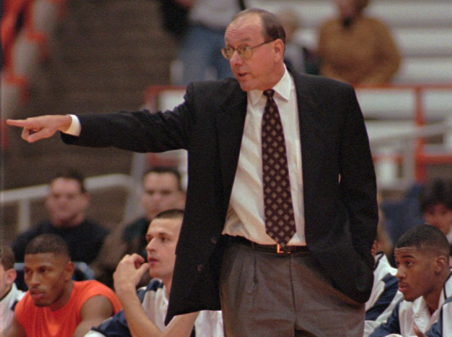 1997: Syracuse head basketball coach Jim Boeheim directs his team against the the Upstate New York Amateur Athletic Union team, as the Orangemen took to the Carrier Dome court for it's first exhibition game Tuesday night, Nov. 4, 1997, in Syracuse, N.Y. Boeheim begins his 22nd season as coach. (AP Photo/Michael Okoniewski)
