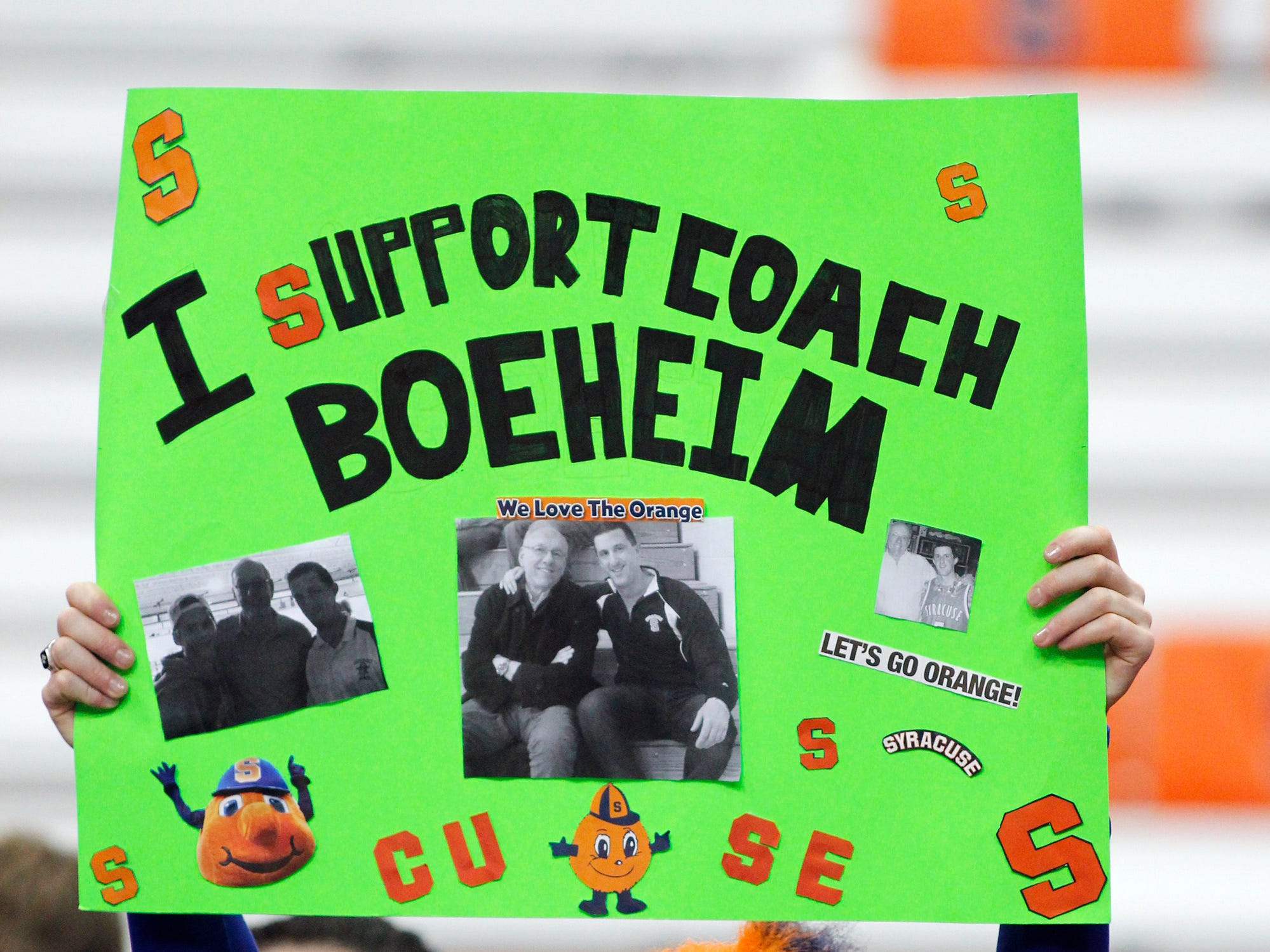 2015: Sean Madden of Oswego, N.Y. holds a sign in support of Syracuse head coach Jim Boeheim before an NCAA college basketball game Syracuse against Montana State in Syracuse, N.Y., Tuesday, Dec. 22, 2015. (AP Photo/Nick Lisi)