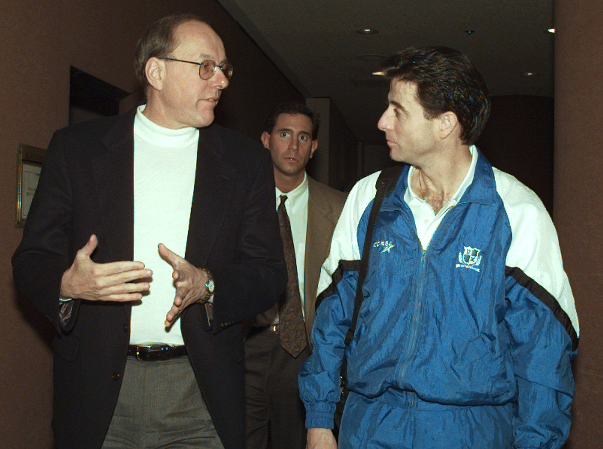 1996: Syracuse coach Jim Boeheim, left, and Kentucky coach Rick Pitino, right, talk as they walk together after an interview session in New York Sunday, March 31, 1996.  The two coaches and their teams face off Monday night in the NCAA college basketball championship game in nearby East Rutherford, N.J.