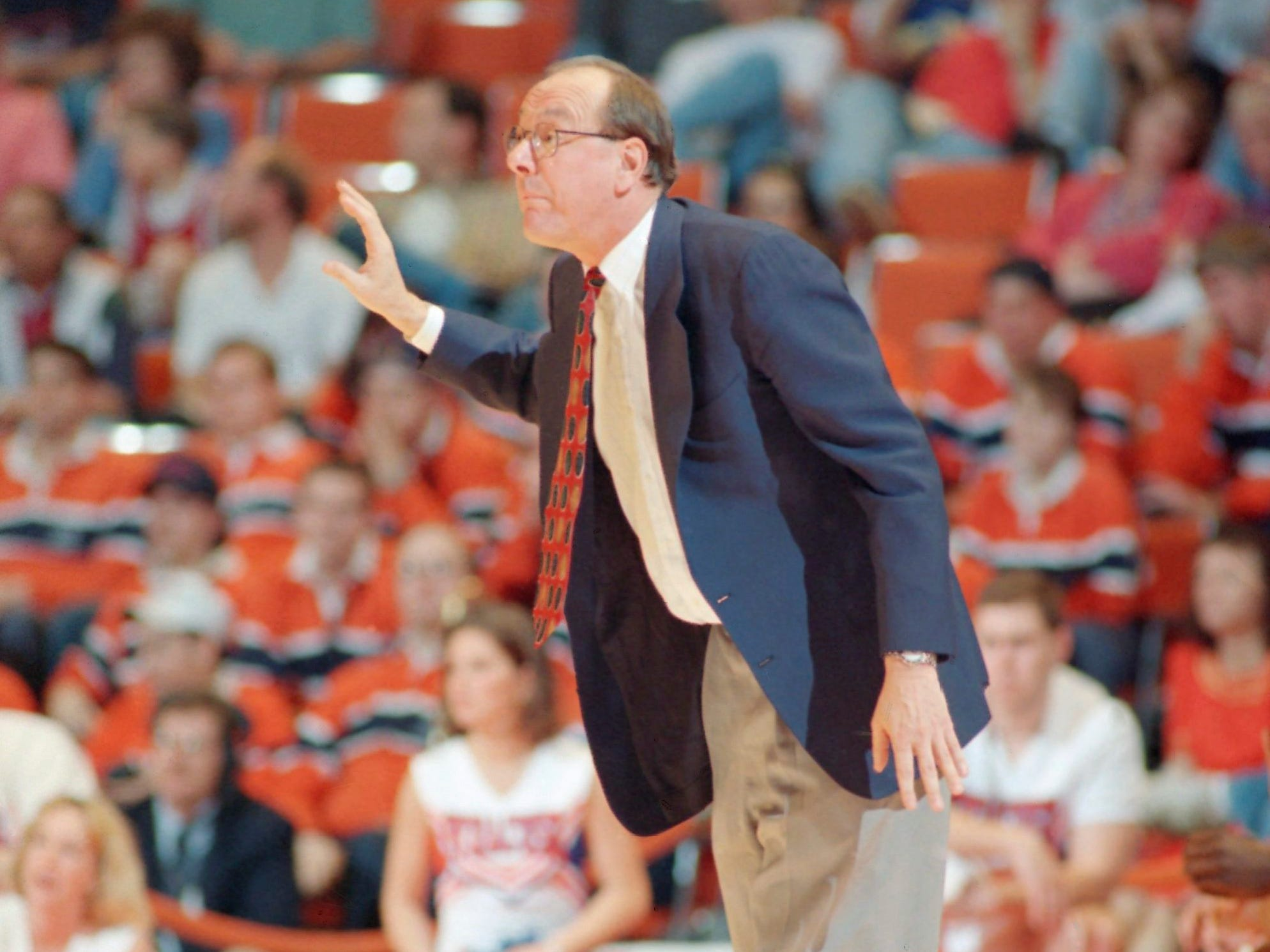 1995: Syracuse coach Jim Boeheim signals to his team during their first round game against Southern Illinois at the NCAA Midwest Regional in Austin, Texas on Friday, March 17, 1995. Syracuse won 96-92. (AP Photo/David J. Phillip)