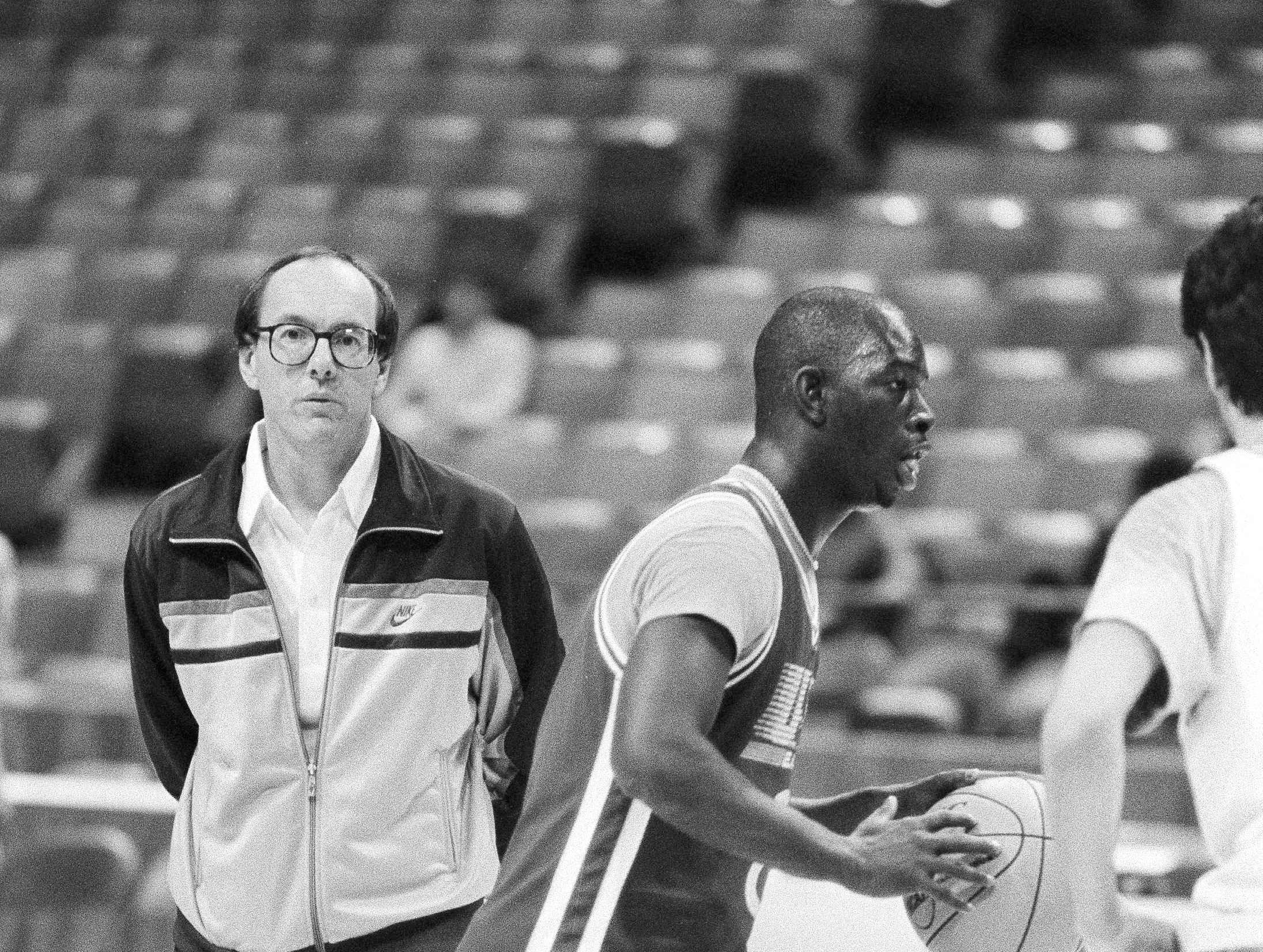 1984: Syracuse coach Jim Boeheim, left, watches as Dwayne Washington looks for a shot during practice at the Omni in Atlanta March 21, 1984 during NCAA regionals matchup against Virginia. (AP Photo/Joe Holloway Jr)