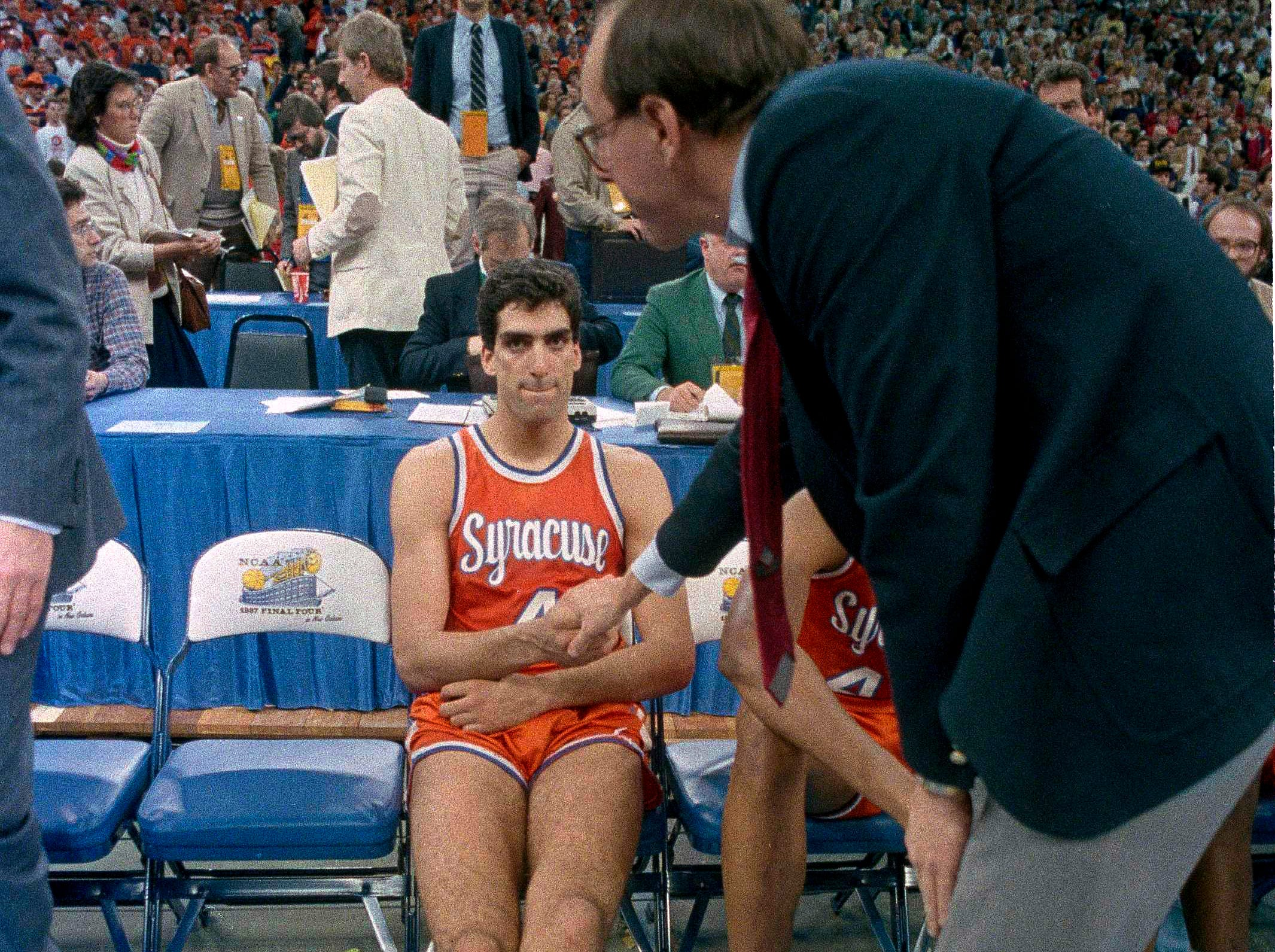 1987: Syracuse coach Jim Boeheim shakes the hand of player Rony Seikaly after they lost the NCAA Championship game to Indiana, 74-73 in New Orleans Monday, March 30, 1987.
