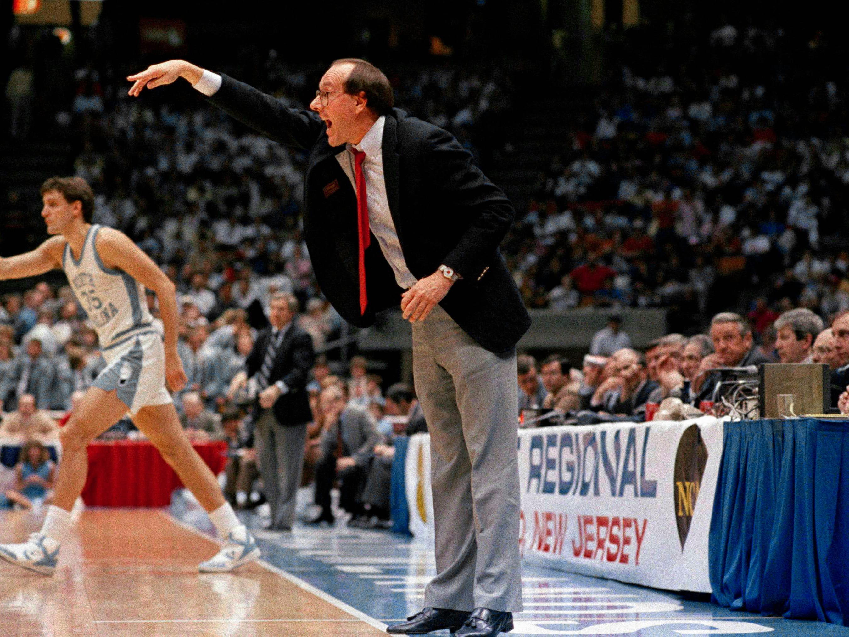 1987: Syracuse coach Jim Boeheim directs the action from the sideline as North Carolina's Dave Popson head toward the action in the East Regional Final in East Rutherford, New Jersey  Saturday, March 21, 1987. Boeheim and his Orangemen beat the Ta Heels 79-75.