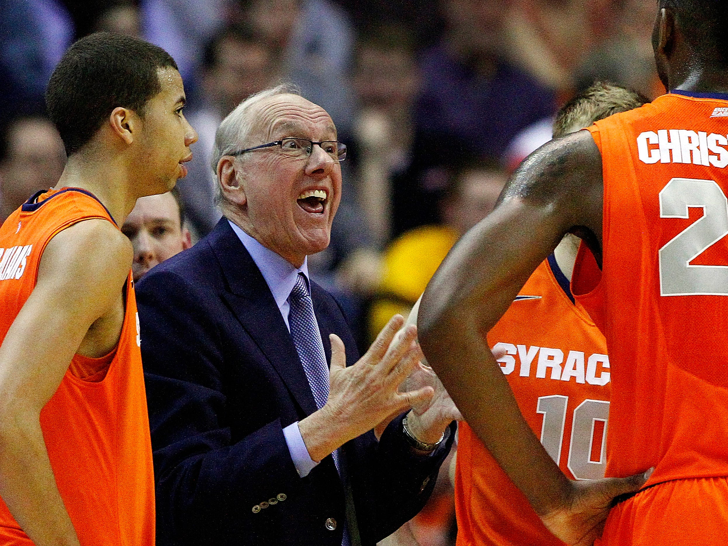 2013: Syracuse head coach Jim Boeheim talks to his players during a timeout in the first half of the East Regional final in the NCAA men's college basketball tournament against Marquette, Saturday, March 30, 2013, in Washington. (AP Photo/Mark Tenally)