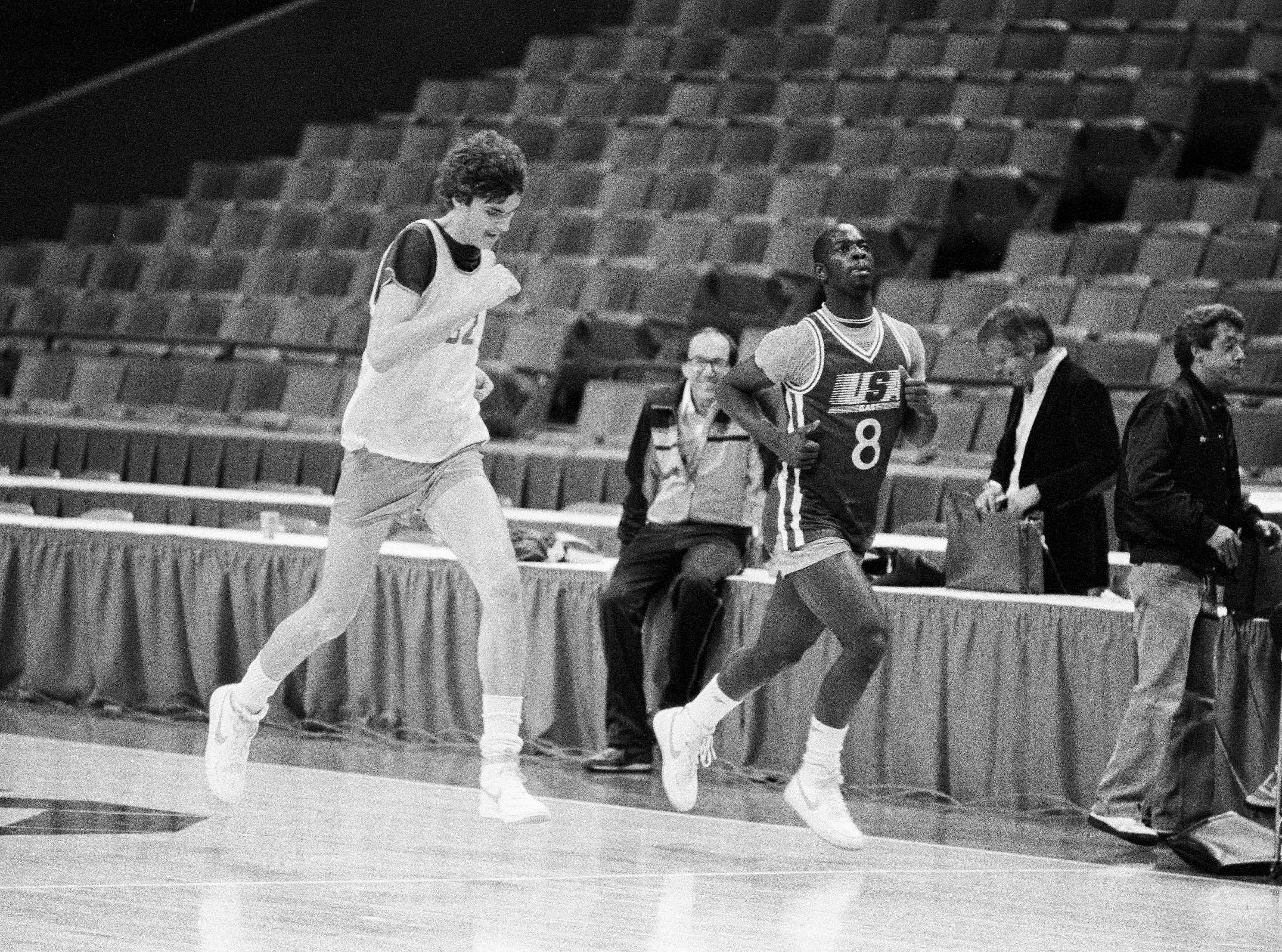 1984: Syracuse basketball coach Jim Boeheim seems pleased as George Papadakos, left, and Dwayne Washington fly past during a workout in Atlanta's Omni, March 22, 1984. (AP Photo/Joe Holloway Jr)