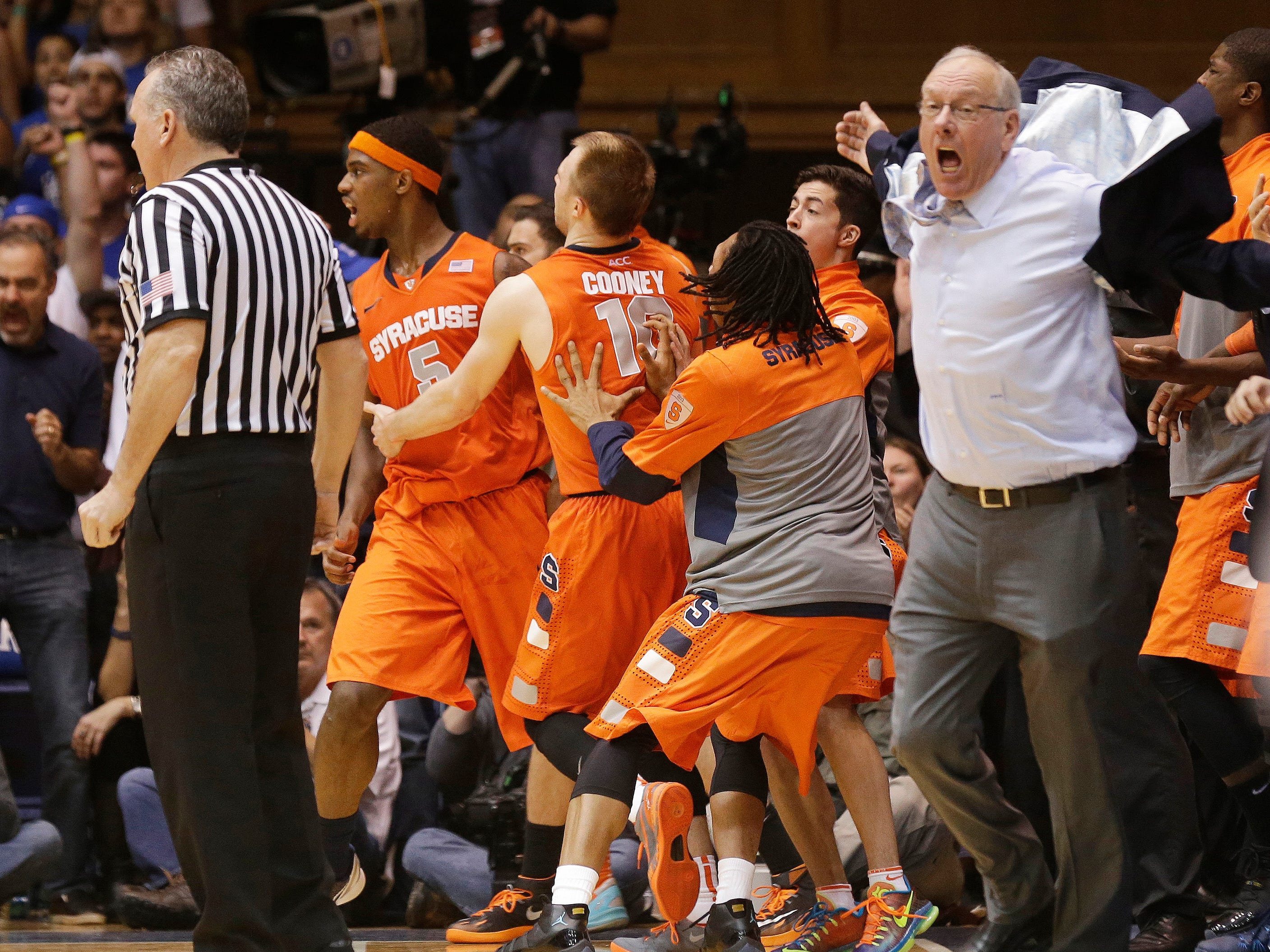 2014: Syracuse coach Jim Boeheim, right, and players react to an official's call late in the second half of an NCAA college basketball game against Duke in Durham, N.C., Saturday, Feb. 22, 2014. Duke won 66-60. (AP Photo/Gerry Broome)
