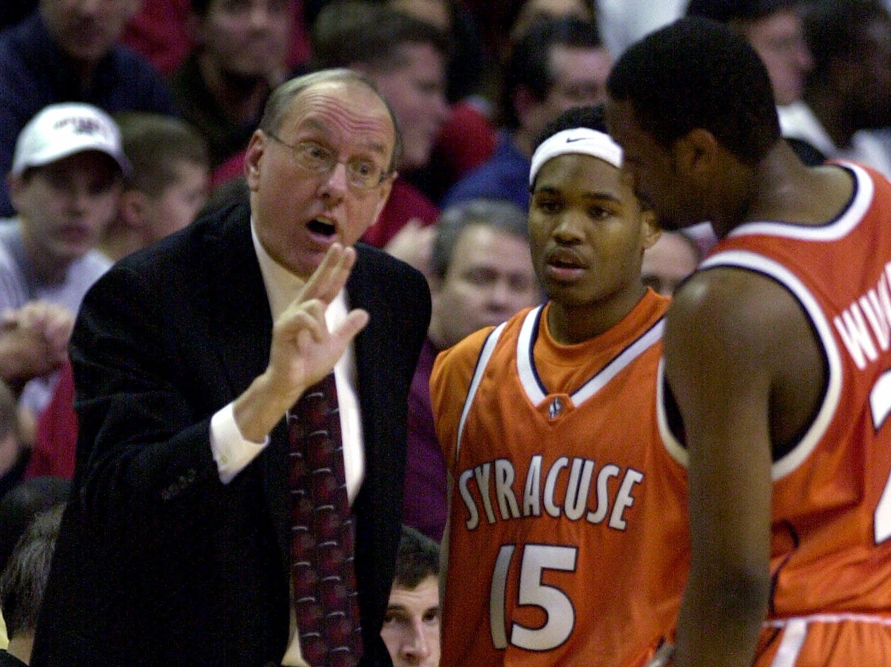 2001: Syracuse head coach Jim Boeheim, left, talks to guard DeShaun Williams, right, as fellow guard James Thues listens during the first half at Rutgers Athletic Center in Piscataway, N.J Tuesday, Jan. 9, 2001. Syracuse held on to defeat Rutgers 64-63. (AP Photo/Daniel Hulshizer)