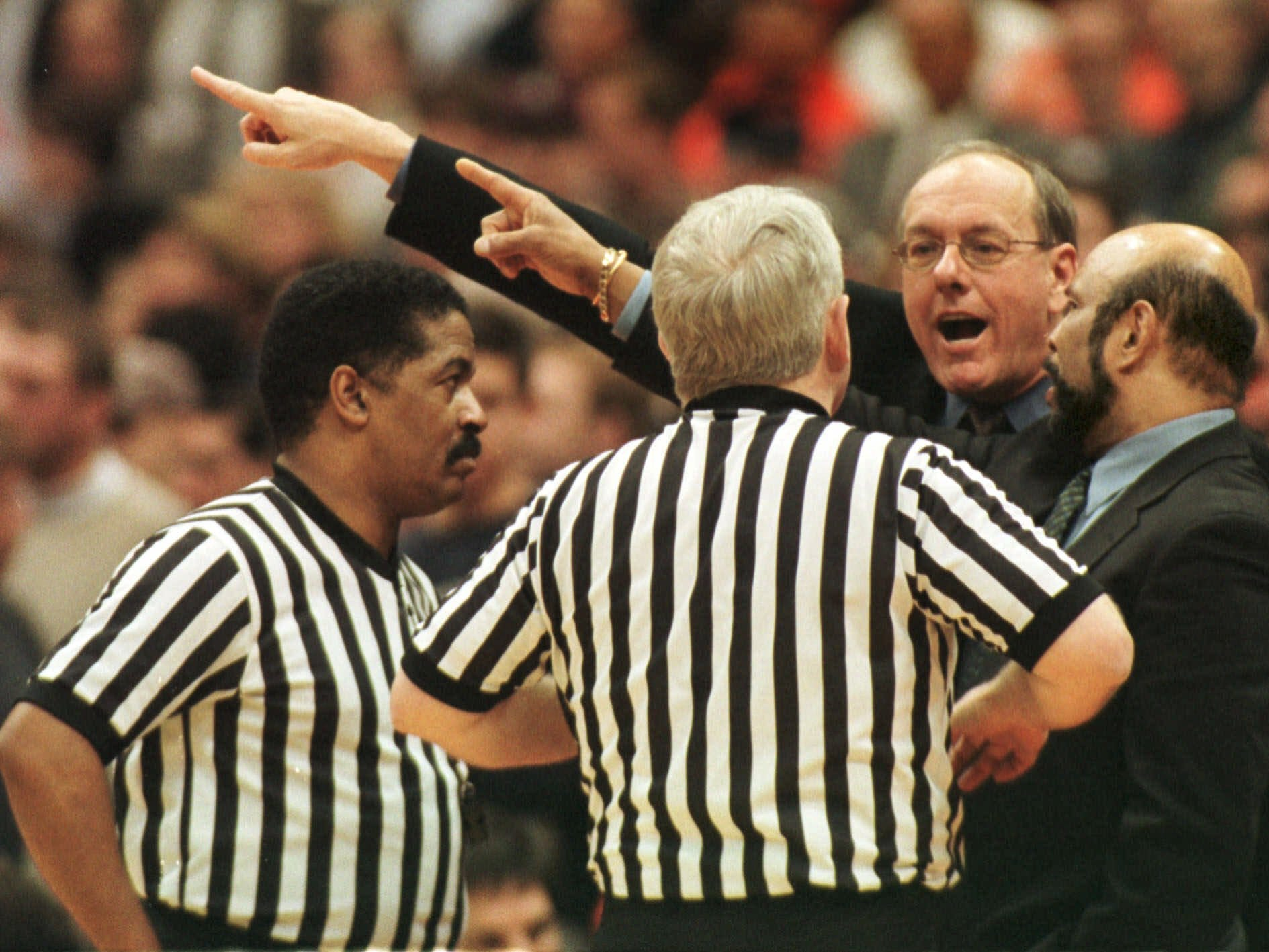 2000: Syracuse coach Jim Boeheim, in glasses, and St. John's coach Mike Jarvis argue with the referees about the game clock in late second half action Monday night, Jan. 31, 2000, in Syracuse, N.Y.  Syracuse held on for a 63-57 win.  (AP Photo/Michael Okoniewski)