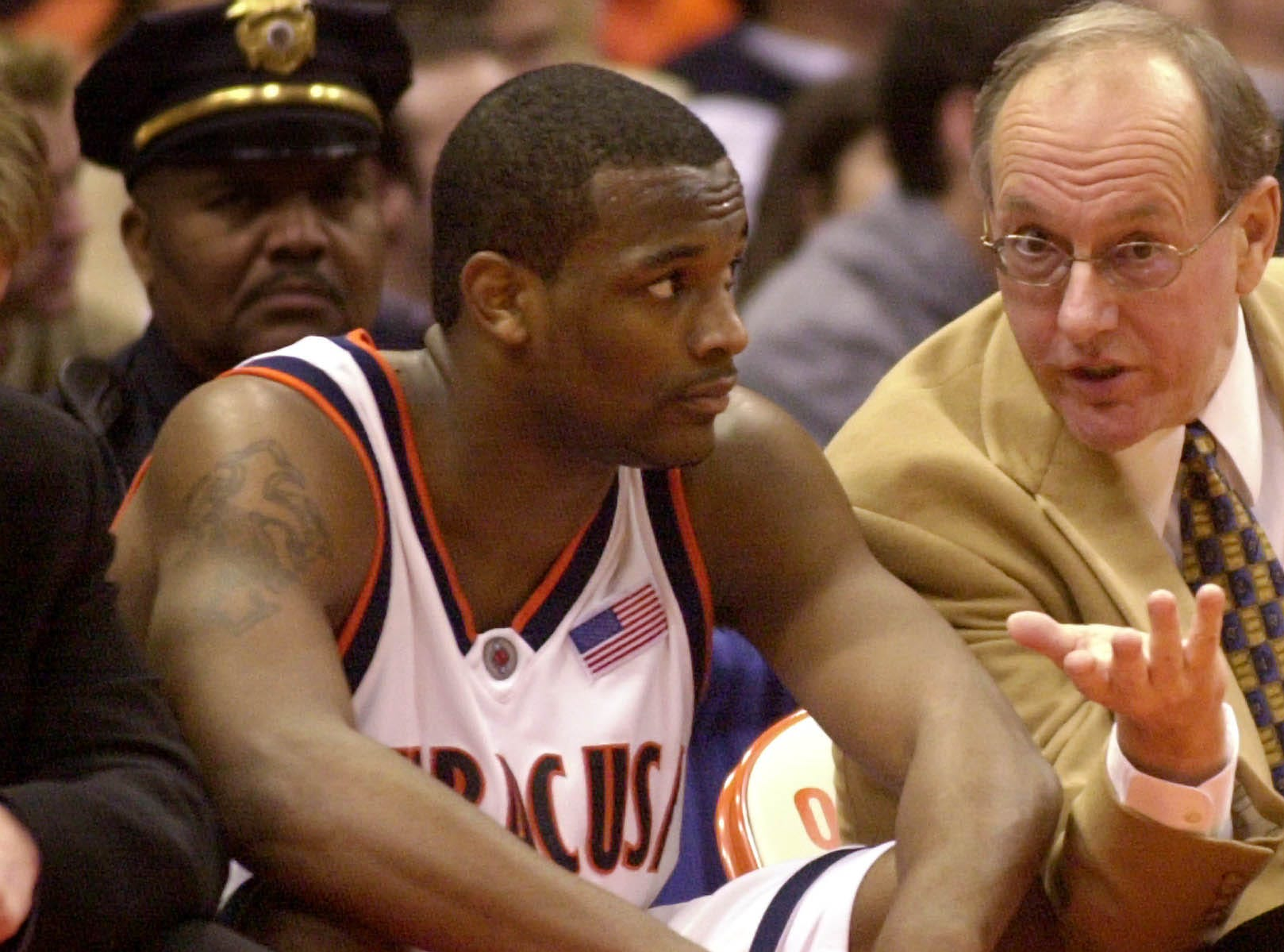 2002: Syracuse's DeShaun Williams listens to head coach Jim Boeheim, right, during the game against Rutgers in Syracuse, N.Y., Wednesday, Jan. 2, 2002. Williams, a 21-year-old junior from Patterson, N.J., was arraigned Thursday, May 9, 2002, for third-degree assault. He is accused of punching student Nicole Wilcox in the face during a dispute at a Syracuse bar early Wednesday, May 8, 2002. (AP Photo/Kevin Rivoli)
