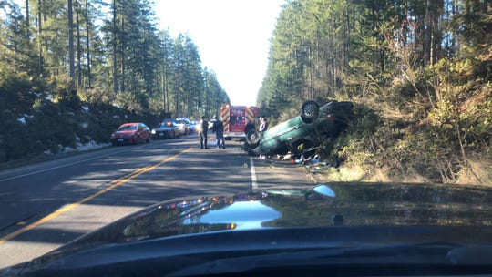 A rollover crash on Highway 3 was caused by a driver using her cell phone, police said.