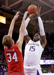 Washington's Noah Dickerson (15) shoots over Utah's Jayce Johnson during the first half of an NCAA college basketball game Wednesday, Feb. 20, 2019, in Seattle.