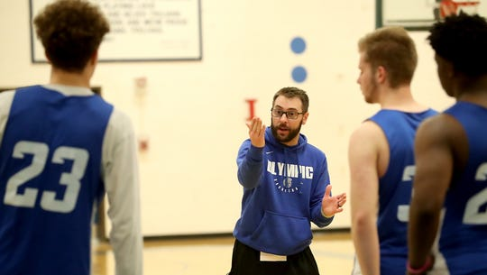 Olympic boys basketball coach  Jon O'Connor gives instructions during practice Wednesday.