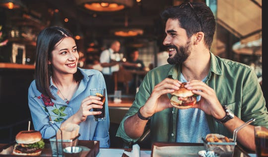 Sitting side-by-side makes conversation easier in noisy restaurants, plus it makes holding hands easier.