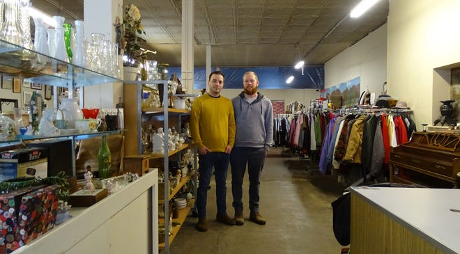 Owners Shawn McGinty, left, and Preston Zornes stand in an aisle at Small City Thrift on Wednesday.