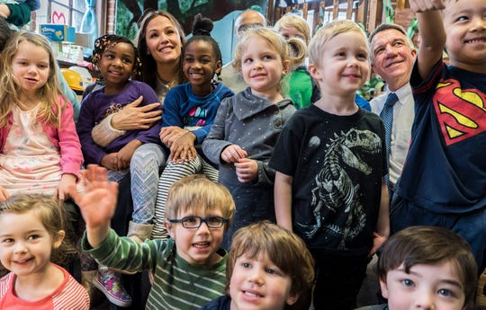 Actress Jennifer Garner poses for photos with kids at the Robin's Nest Children's Center in Burlington along with Gov. Phil Scott, right, on Thursday morning, Feb 21, 2019. Garner and Mark K. Shriver, CEO of Save the Children Action Network (SCAN), came to Vermont to highlight the educational and economic impacts of increasing access to high-quality, affordable child care.