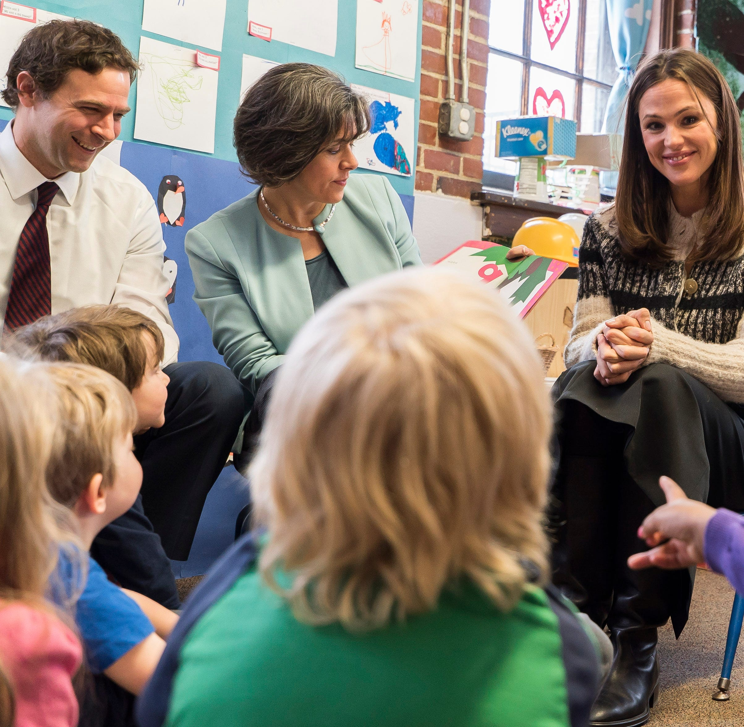 From left, Senate President Pro Tem Tim Ashe, House Speaker Mitzi Johnson, Actress Jennifer Garner and Gov. Phil Scott read books to kids at the Robin's Nest Children's Center in Burlington on Thursday morning, Feb 21, 2019. Garner and Mark K. Shriver, CEO of Save the Children Action Network (SCAN), came to Vermont to highlight the educational and economic impacts of increasing access to high-quality, affordable child care.
