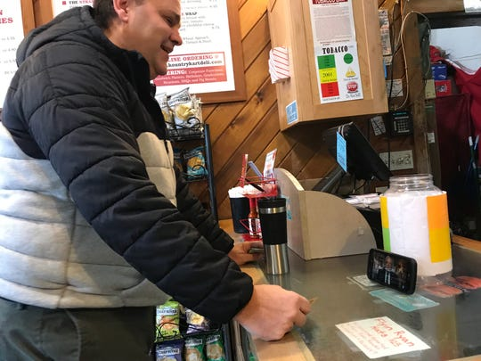 Scott Hubbard, a regular at Kountry Kart Deli, waits for his order and watches a Jimmy Fallon sketch. The talk show host impersonates Bernie Sanders and names the deli. Feb. 21, 2019.
