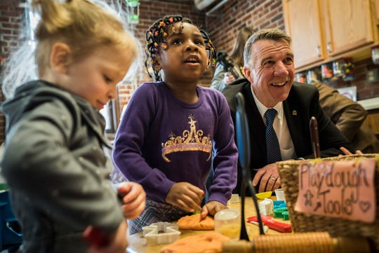 Right, Gov. Phil Scott jokes with kids at the Robin's Nest Children's Center in Burlington on Thursday morning Feb 21, 2019, before actress Jennifer Garner with Save the Children Action Network (SCAN) talked at a news conference highlighting the educational and economic impacts of increasing access to high-quality, affordable child care.