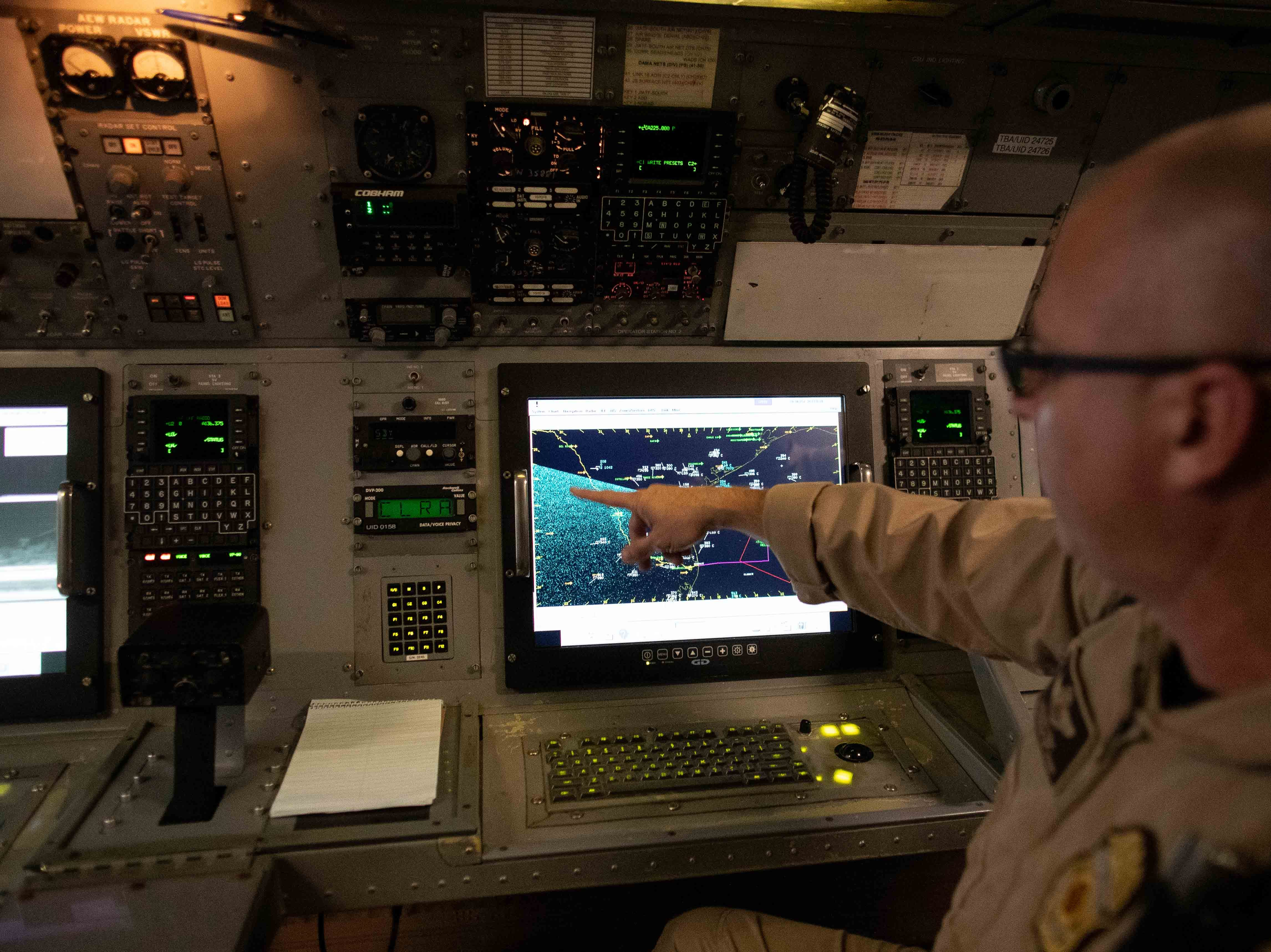 A Customs and Border Protection agent demonstrates how the radar works on a P-3 Orion aircraft at their National Air Security Operations Center on Navy Air Station Corpus Christi on Wednesday, Feb. 20, 2019.